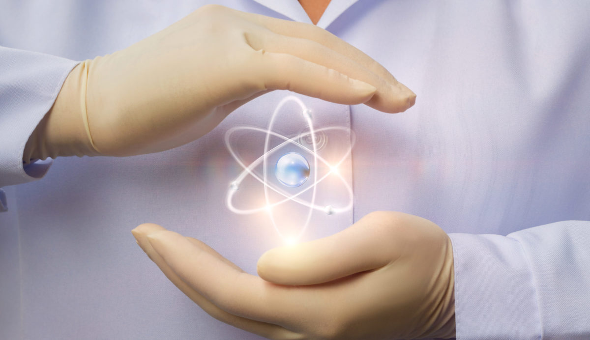 Protection of peaceful nuclear energy in the hands of the scientist. Shutterstock