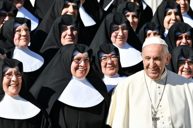 Pope Francis poses with a group of nuns at the end of the weekly general audience on October 24, 2018 at St. Peter's square in the Vatican. ( VINCENZO PINTO/AFP/Getty Images)