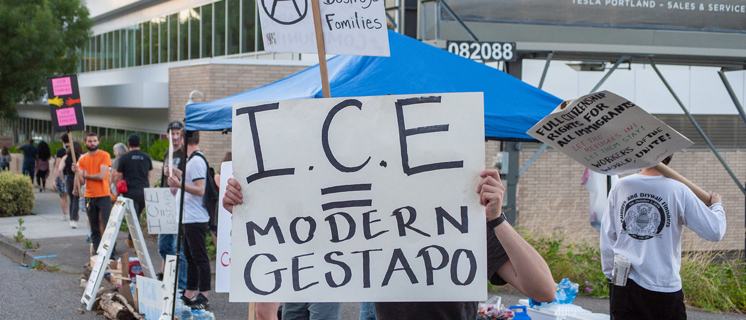 """JUNE 19, 2018 - PORTLAND, OR: Occupy ICE is born when a crowd gathers to camp out in front the ICE Portland field office to protest the Trump administration """"Zero Tolerance"""" policy on immigration. (Diego G. Diaz/Shutterstock)"""