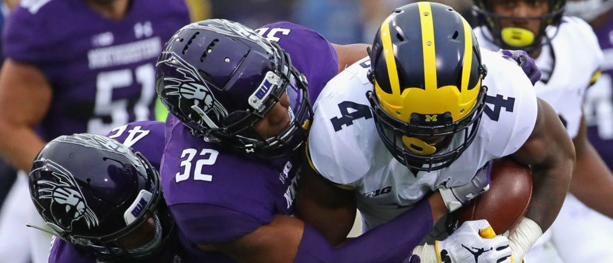 bring down Nico Collins #4 of the Michigan Wolverines at Ryan Field on September 29, 2018 in Evanston, Illinois. (Photo by Jonathan Daniel/Getty Images)