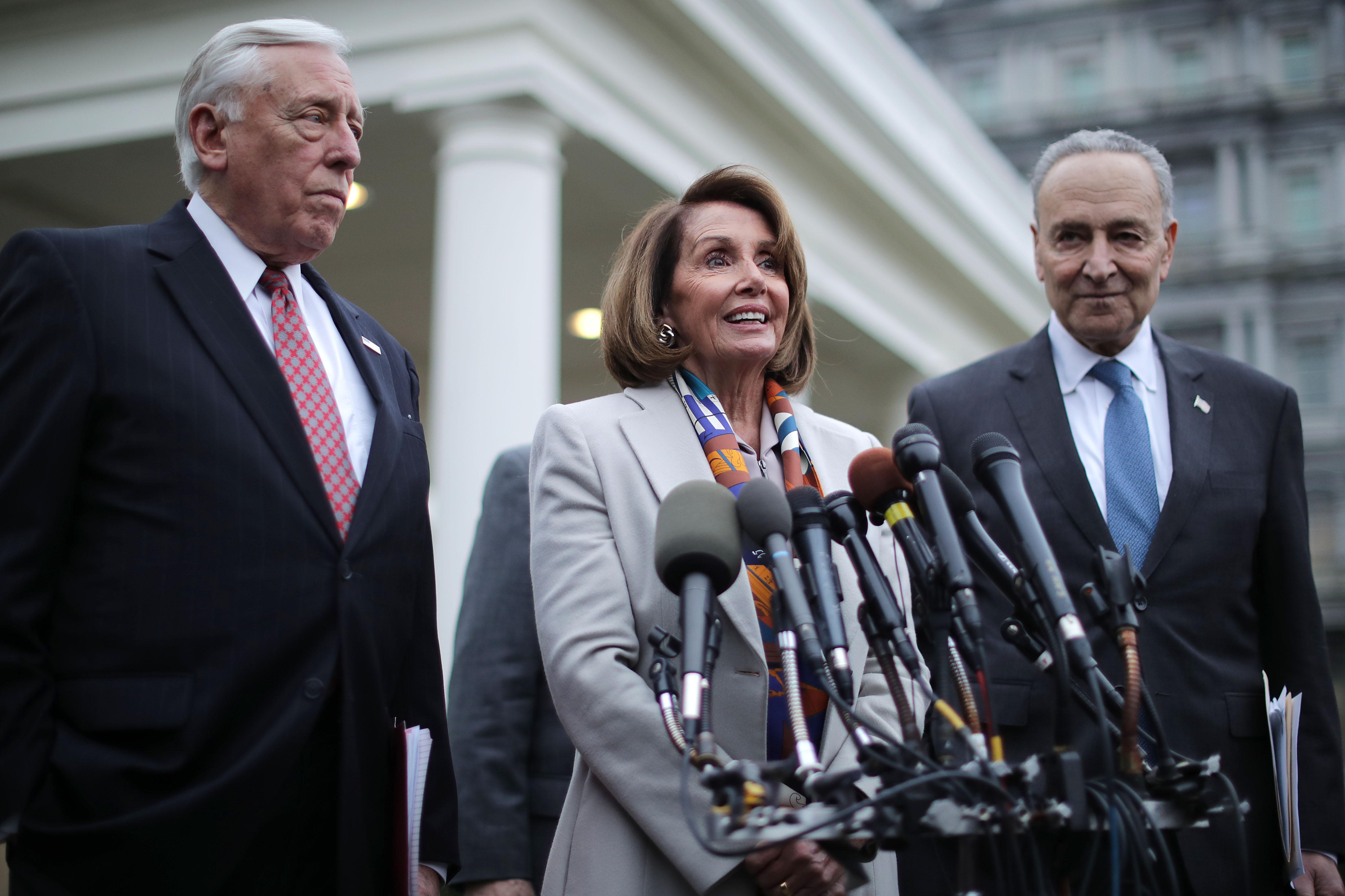 House Minority Whip Steny Hoyer, House Speaker designate Nancy Pelosi and Senate Minority Leader Charles Schumer talk to journalists (Chip Somodevilla/Getty Images)