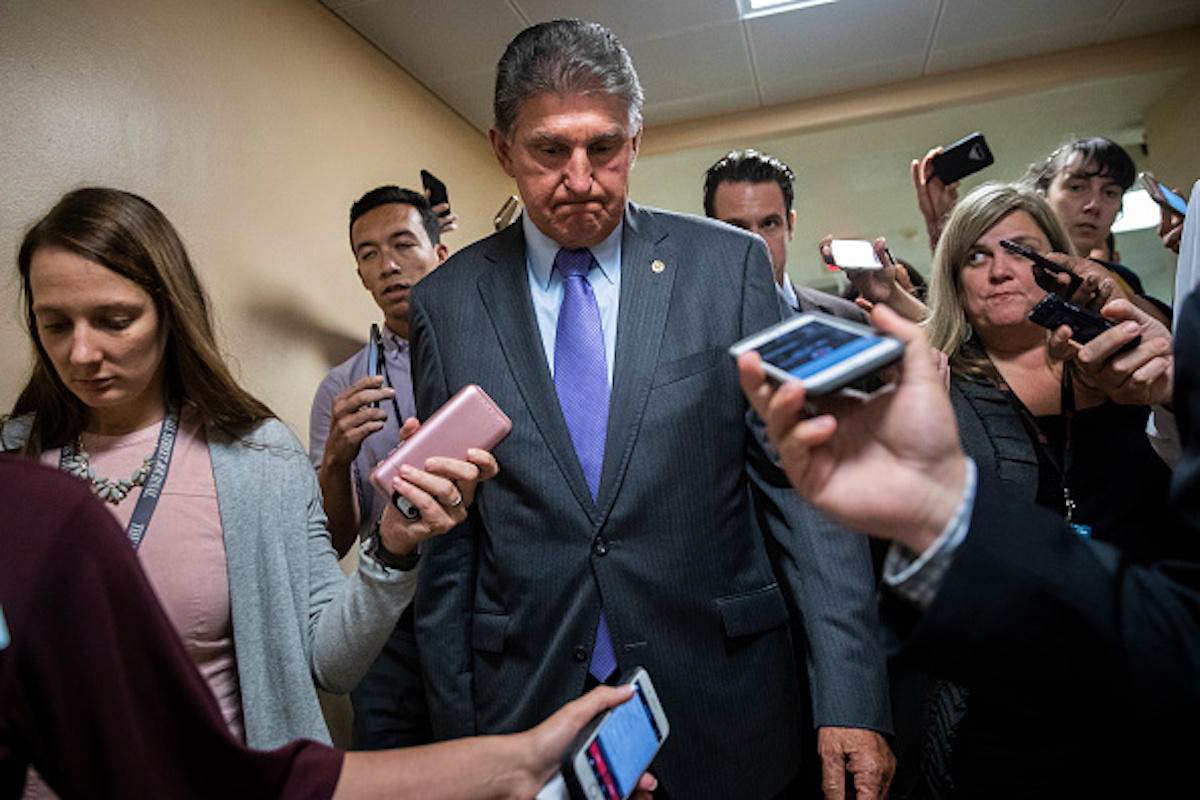 WASHINGTON, DC - SEPTEMBER 24: Sen. Joe Manchin (D-WV) speaks to reporters on his way to a vote on Capitol Hill, September 24, 2018 in Washington, DC. Christine Blasey Ford, who has accused Kavanaugh of sexual assault, has agreed to testify before the Senate Judiciary Committee on Thursday. (Photo by Drew Angerer/Getty Images)
