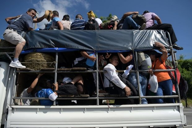 Salvadoran migrants embark on a journey in caravan to the United States, in San Salvador on October 31, 2018. (MARVIN RECINOS/AFP/Getty Images)