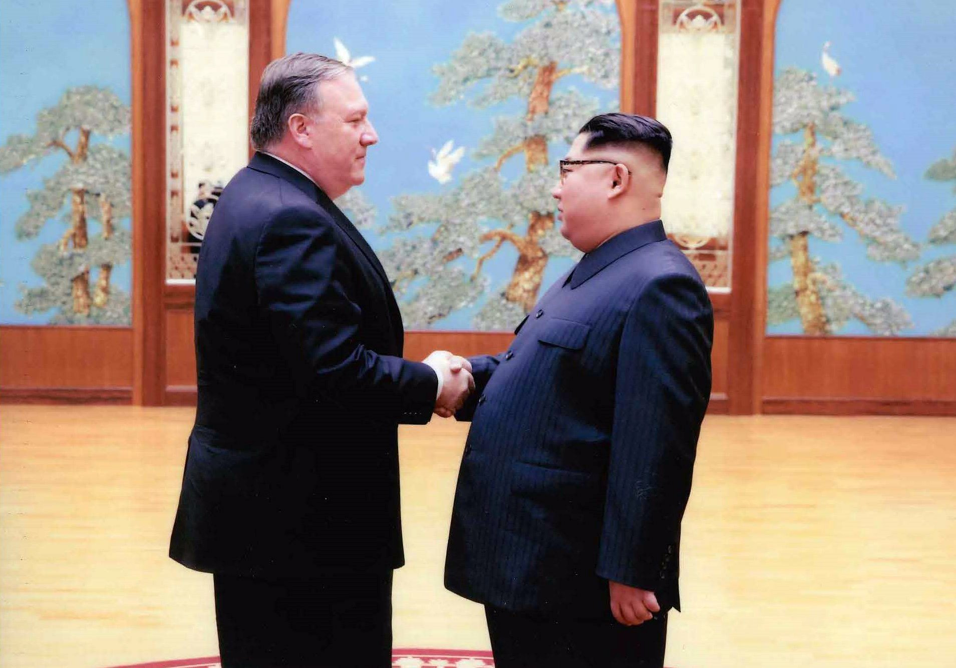 PYONGYANG, NORTH KOREA - UNDATED: In this handout provided by The White House, CIA director Mike Pompeo (L) shakes hands with North Korean leader Kim Jong Un in this undated image in Pyongyang, North Korea. (The White House via Getty Images)
