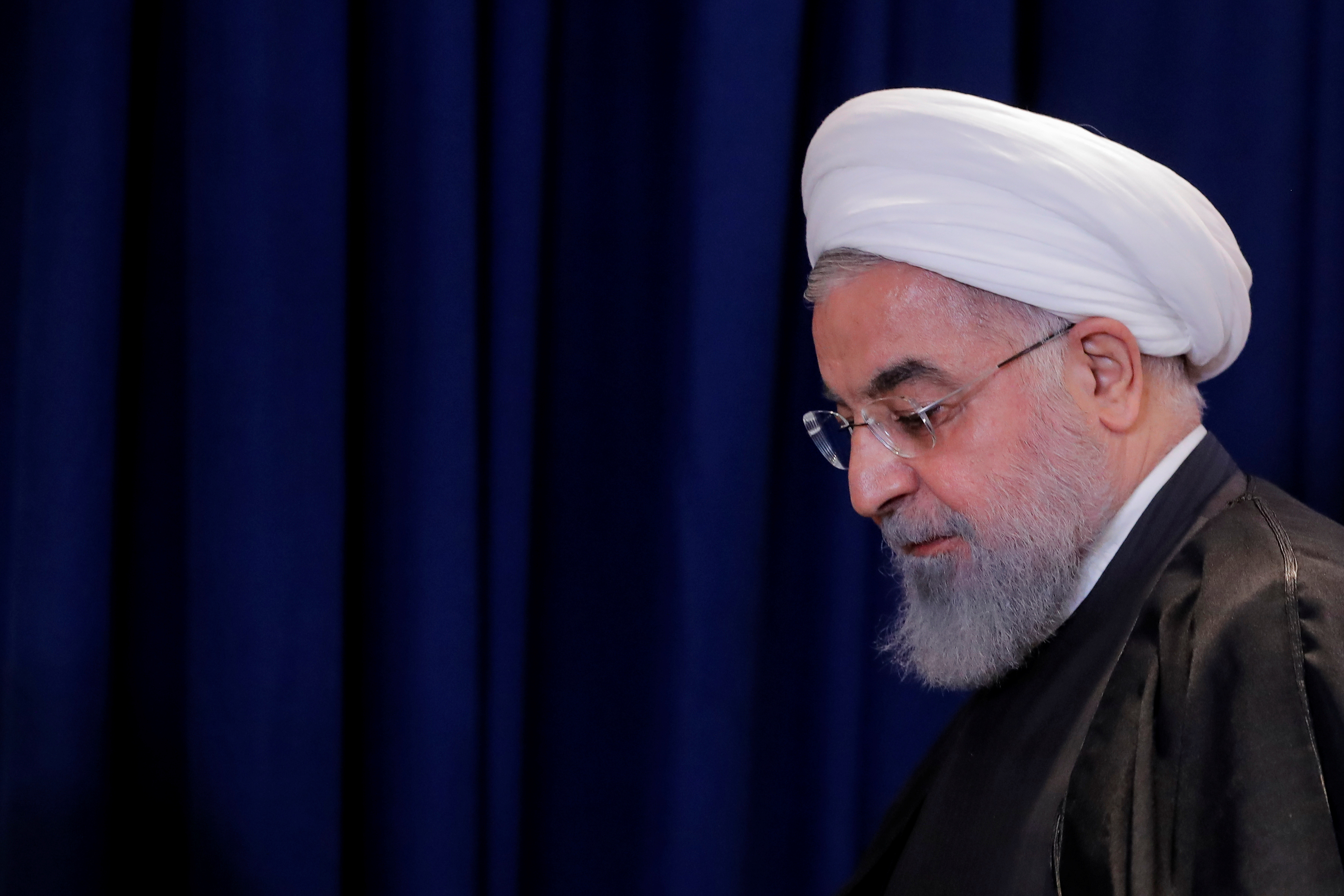 Iran's President Rouhani exits following a news conference in New York