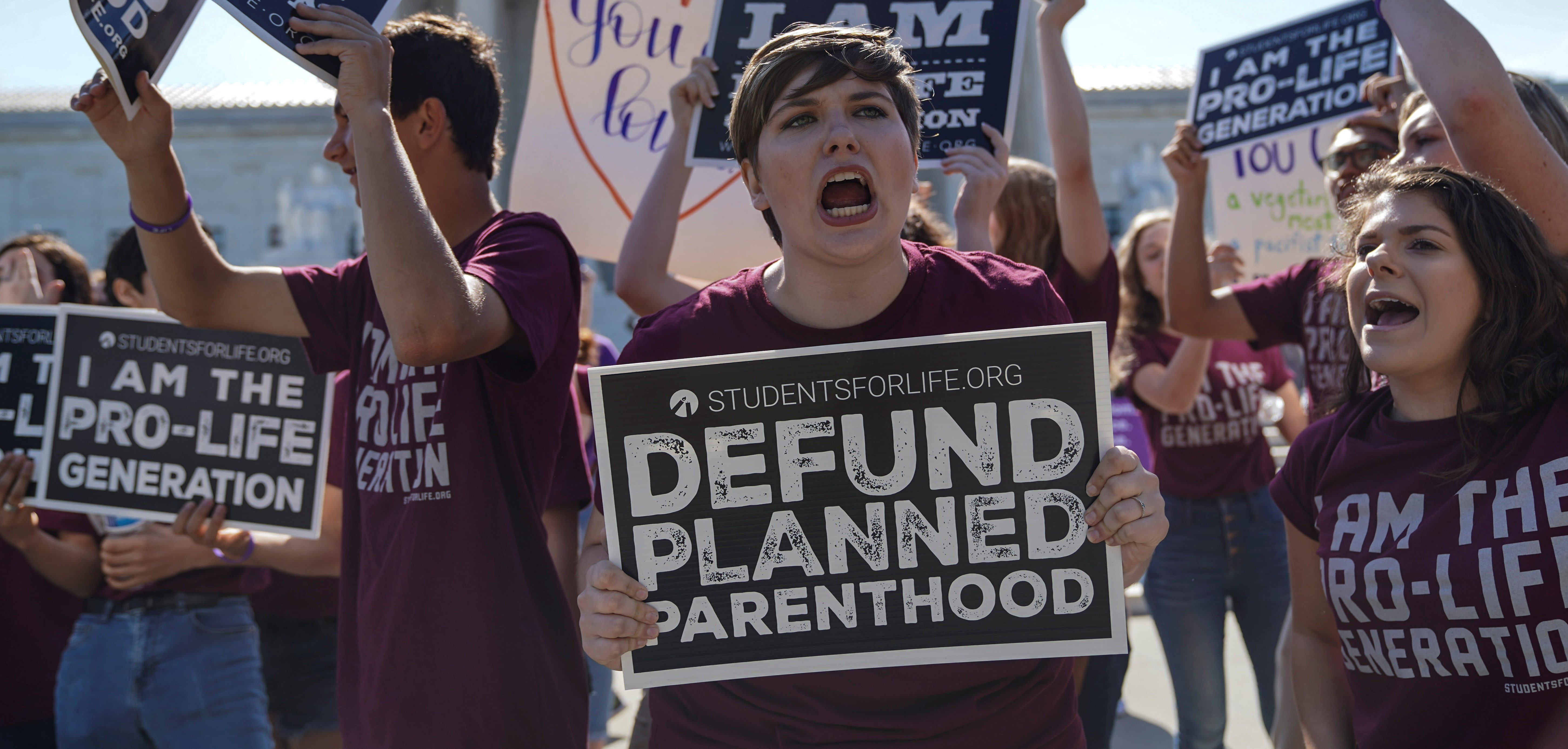 Pro-life and pro-choice protesters rally outside the U.S. Supreme Court waiting for the National Institute of Family and Life Advocates v. Becerra case, which remains pending, in Washington, U.S., June 25, 2018. REUTERS/Toya Sarno Jordan