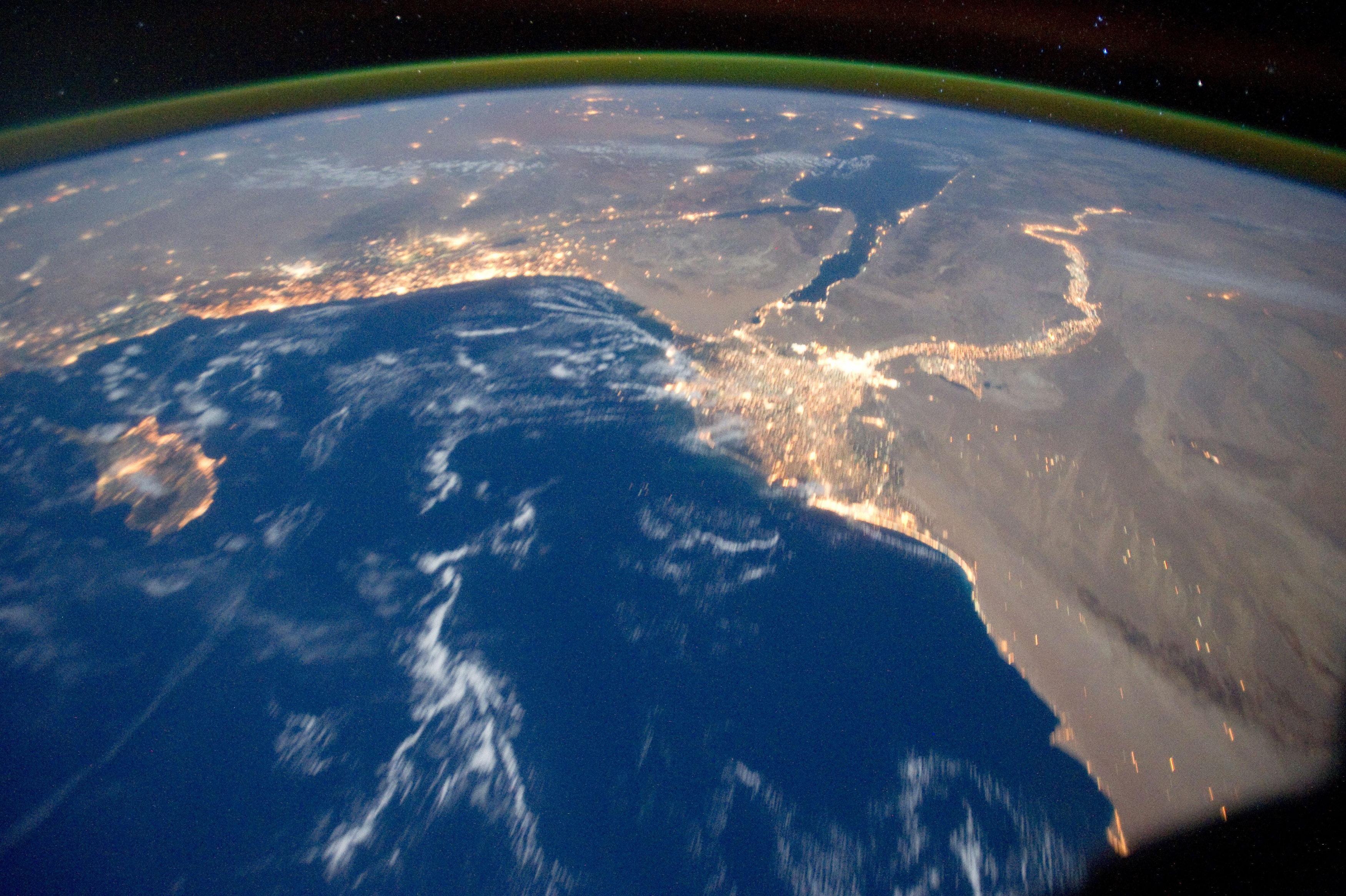 Earth's airglow is seen with an oblique view of the Mediterranean Sea area, including the Nile River with its delta and the Sinai Peninsula, in this October 15, 2011 NASA handout photograph taken by a crew member of Expedition 29 aboard the International Space Station. Some areas of the photo like the river and river delta appear as the brightest areas because of either man-made lighting (mostly incandescent) or man-made lighting reflected off nearby surfaces. The other areas appear to be illuminated naturally by moonlight, starlight, or back-scattered light from the atmosphere, according to NASA. Picture taken October 15, 2011. REUTERS/NASA/Handout