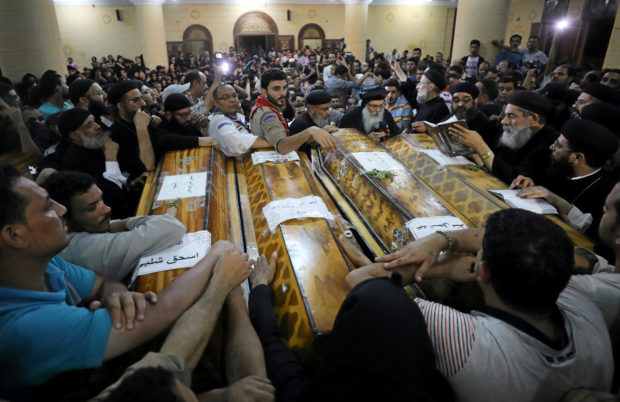 Mourners gather at the Sacred Family Church for the funeral of Coptic Christians who were killed in Minya