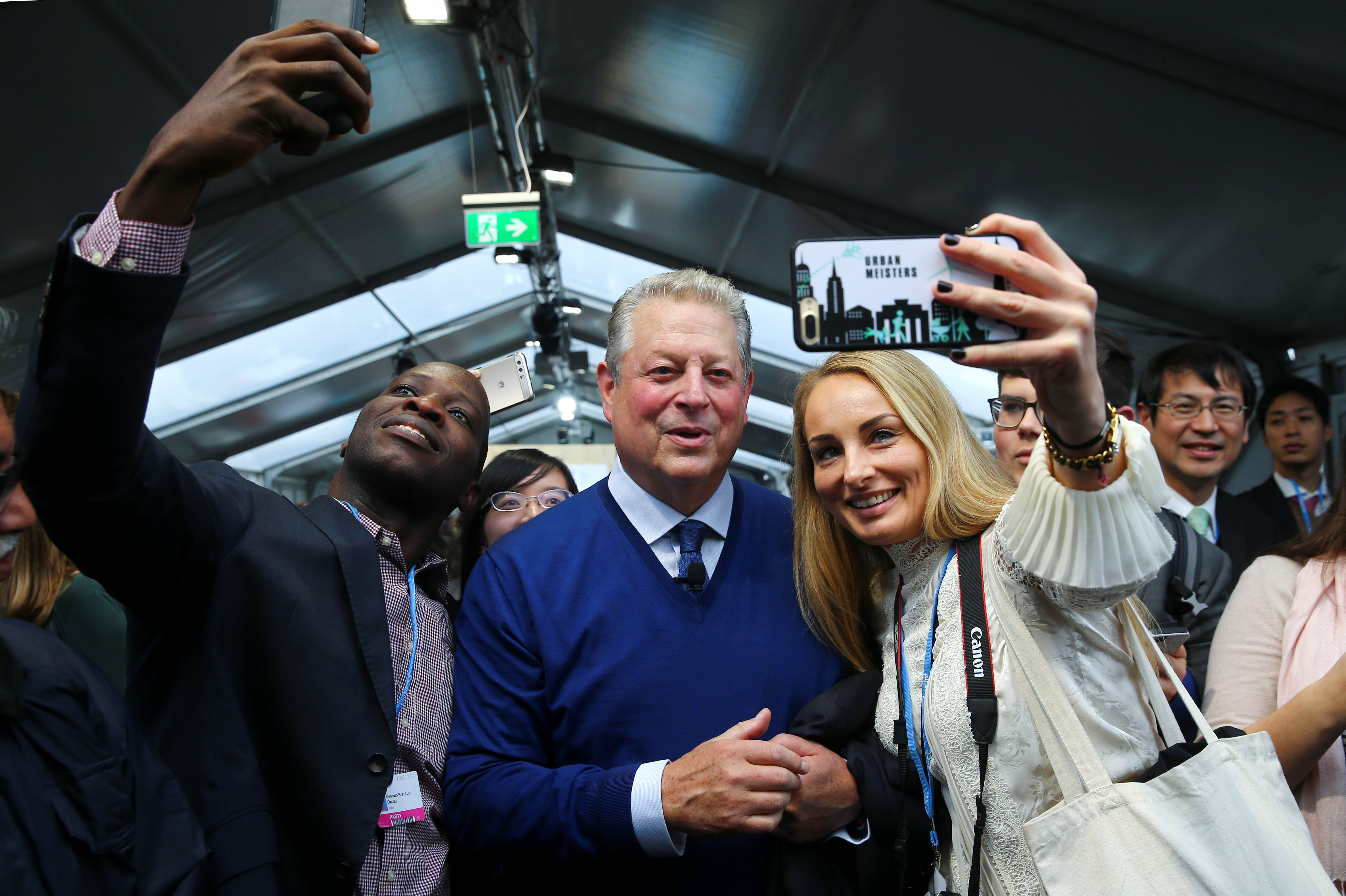 Former U.S. Vice President Al Gore poses for selfies with delegates and observers of the COP23 UN Climate Change Conference 2017, hosted by Fiji but held in Bonn