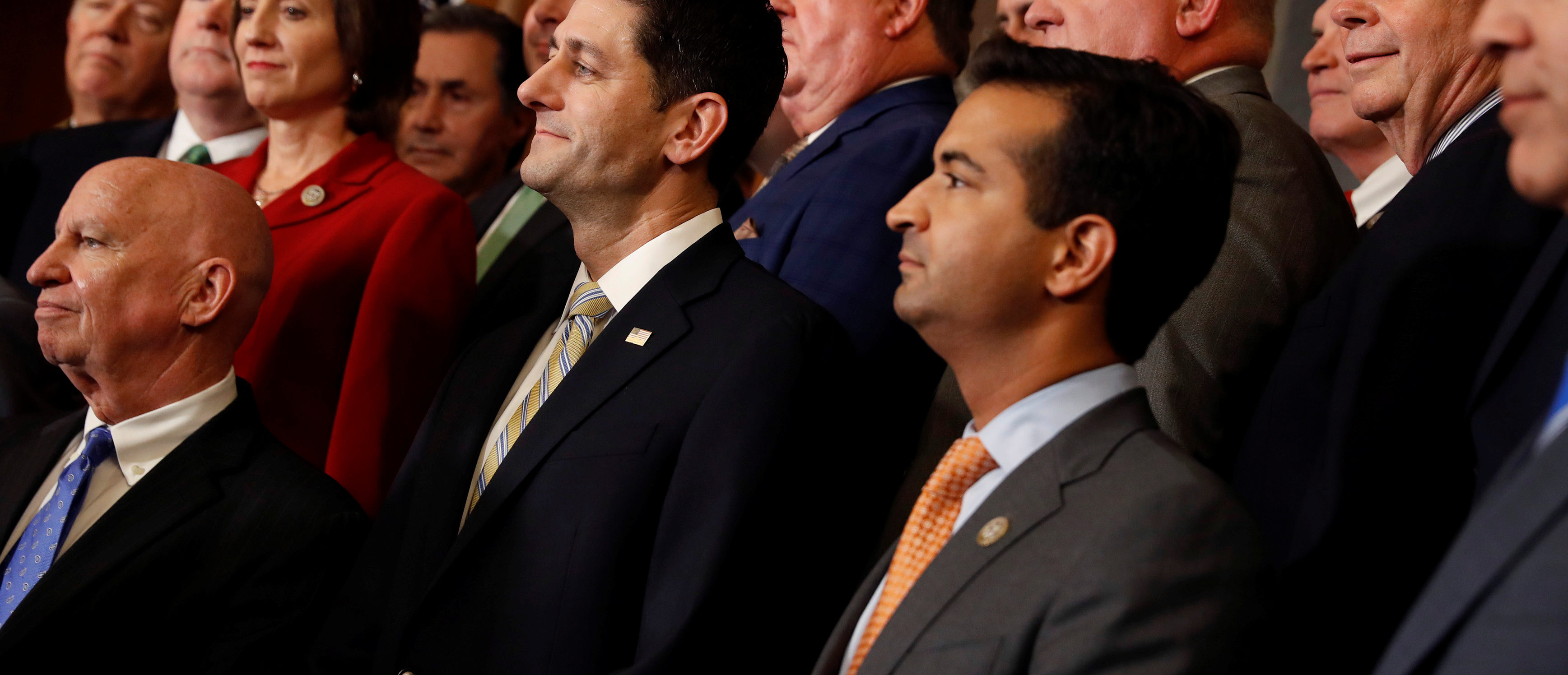 """Rep. Kevin Brady (R-TX), Speaker of the House Paul Ryan and Rep. Carlos Curbelo (R-FL) look on during a news conference announcing the passage of the """"Tax Cuts and Jobs Act"""" at the U.S. Capitol in Washington, U.S., November 16, 2017. REUTERS/Aaron P. Bernstein -"""