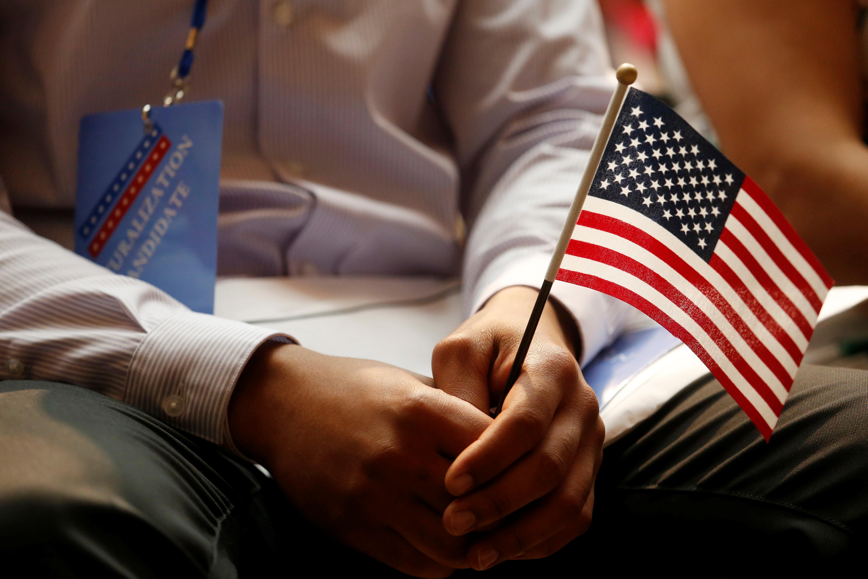 A new citizen holds a U.S. flag