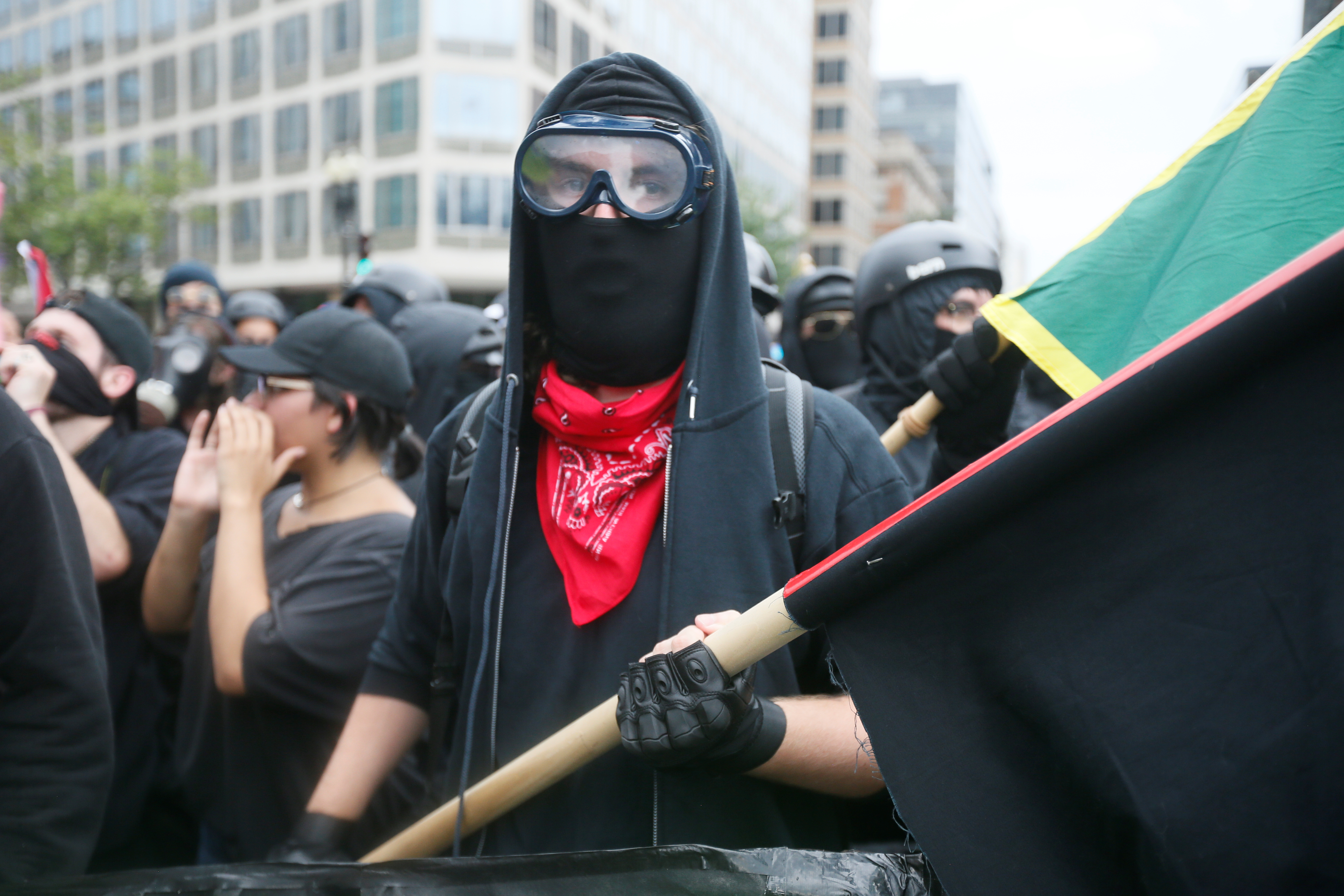 Antifa, opponents of white nationalist, Jason Kessler's group, march during a rally, marking the one year anniversary of the 2017 Charlottesville 'Unite the Right' protests in Washington, U.S., August 12, 2018. REUTERS/Jim Bourg - RC1C47688FA0