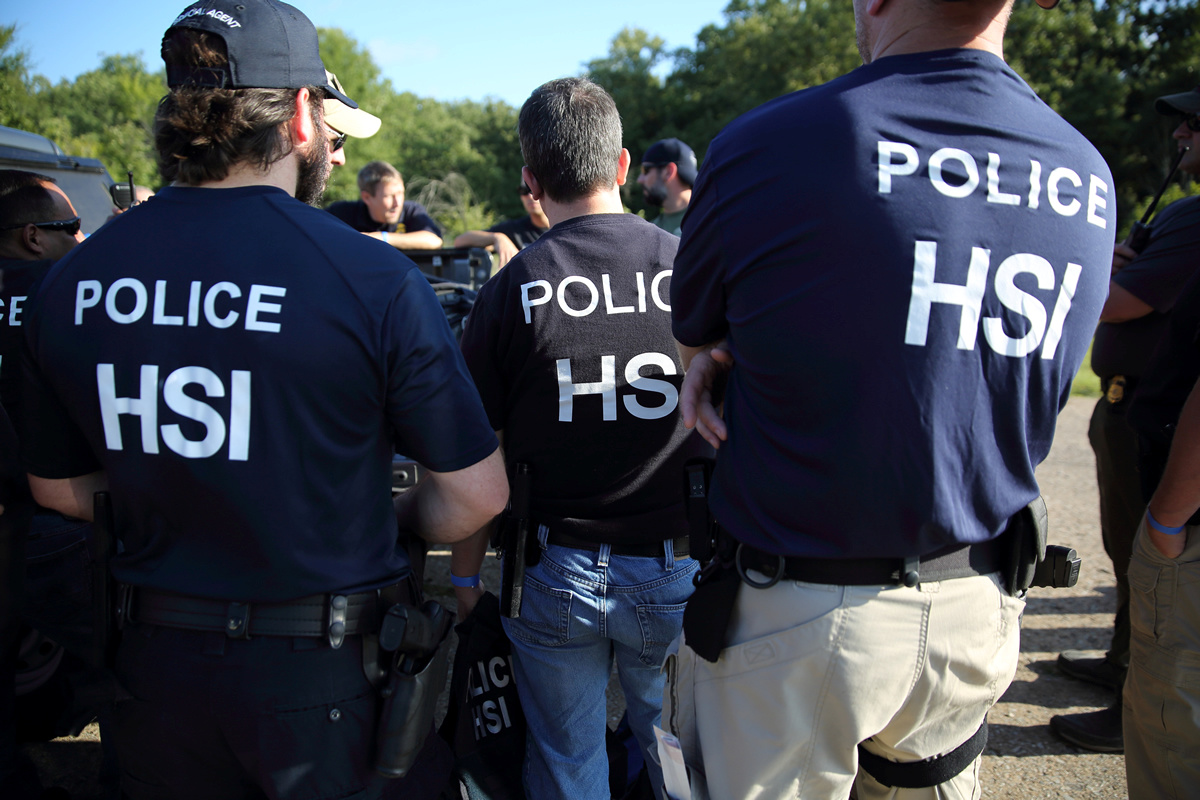 U.S. Immigration and Customs Enforcement's (ICE) Homeland Security Investigations (HSI) officers execute criminal search warrants and arrest more than 100 company employees on federal immigration violations at a trailer manufacturing business in Sumner, Texas, U.S, August 28, 2018. Picture taken August 28, 2018. U.S. Immigration and Customs Enforcement/Handout via REUTERS ATTENTION EDITORS - THIS IMAGE WAS PROVIDED BY A THIRD PARTY. - RC1EE7047640