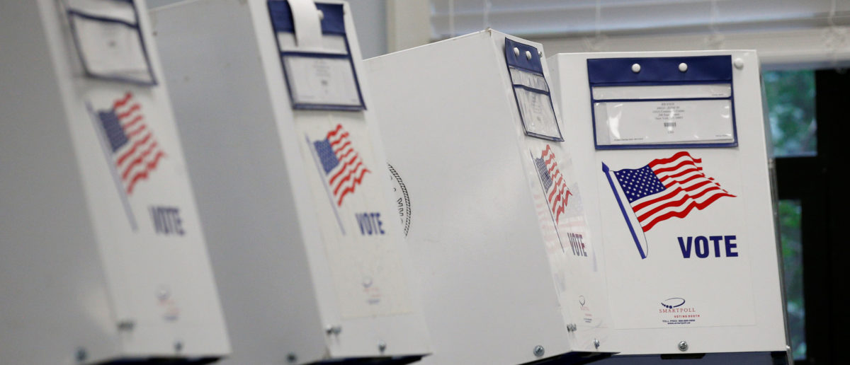 Voting booths are seen at a polling site during the New York State Democratic primary in New York City, U.S., September 13, 2018. REUTERS/Brendan McDermid - RC1303206050