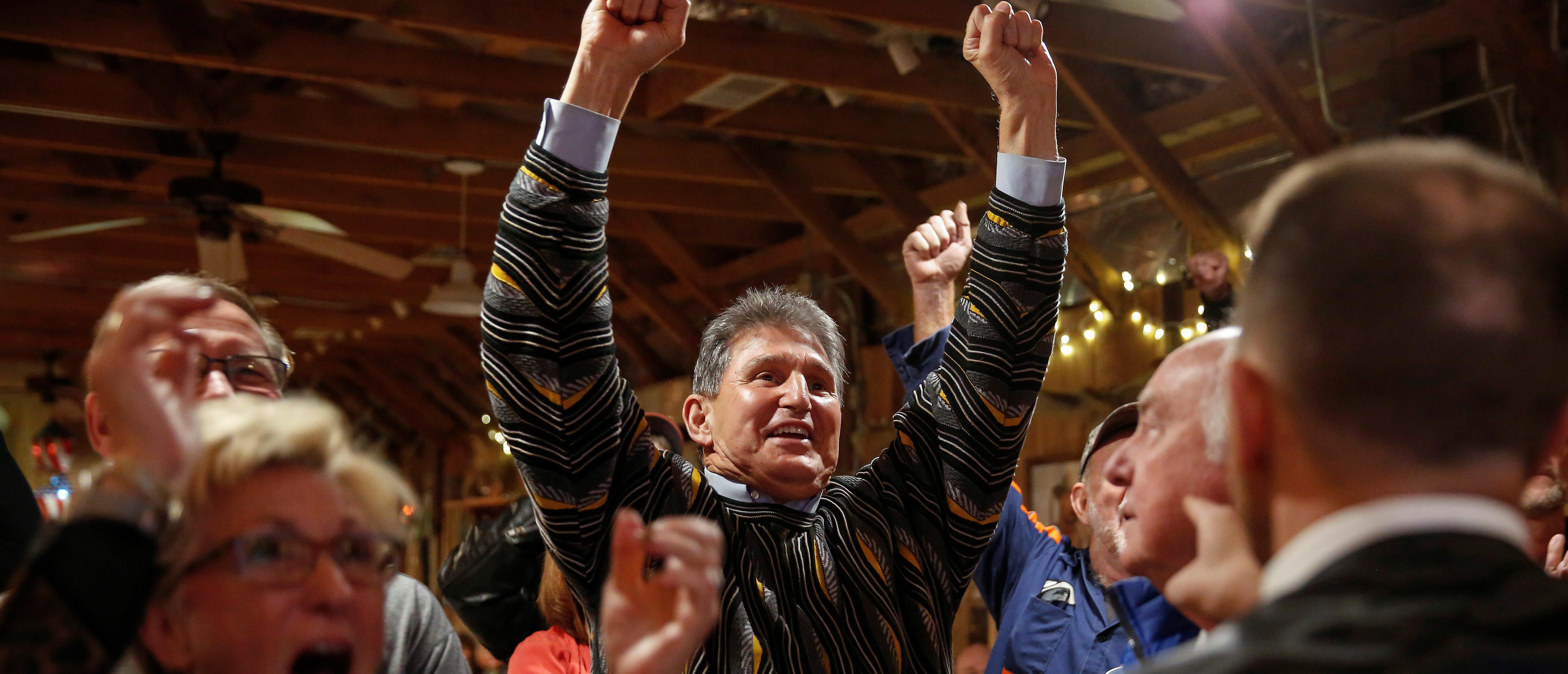Senator Joe Manchin (D-WV) celebrates West Virginia University's victory over Texas University in football, ahead of 2018 midterm elections, at Hound Dog Adkins Barn in Peach Creek, West Virginia, U.S., November 3, 2018. REUTERS/Joshua Roberts