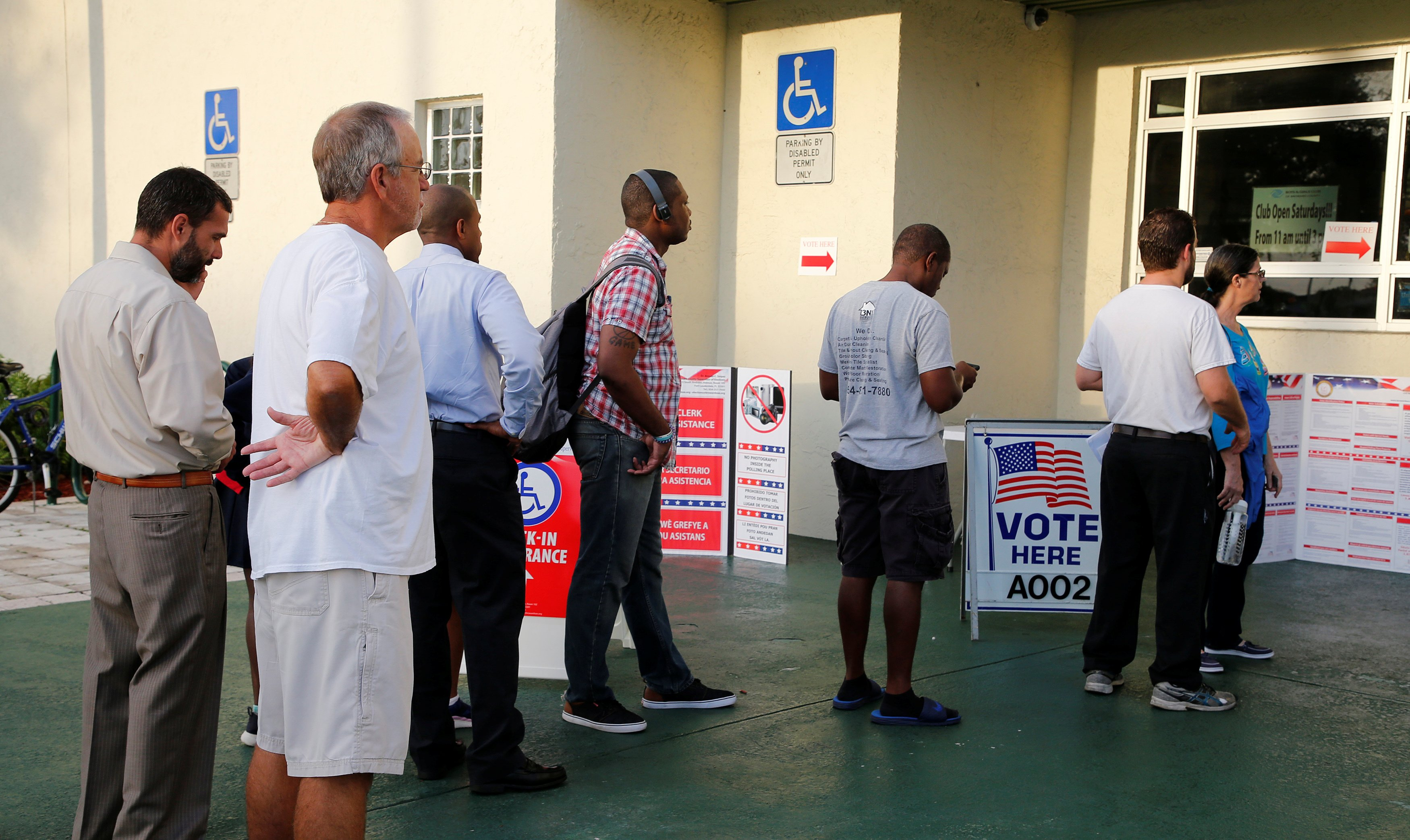Voters line up to vote in the U.S. midterm congressional and gubernatorial elections in Deerfield Beach