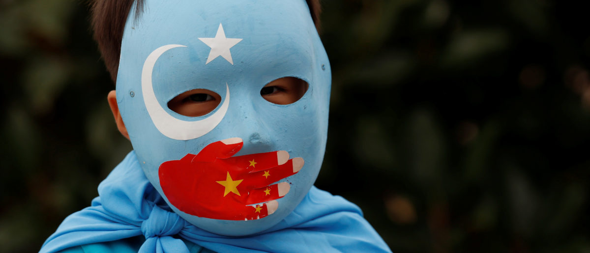 An ethnic Uighur boy living in Turkey, takes part in a protest against China, in Istanbul, Turkey Nov. 6, 2018. REUTERS/Murad Sezer