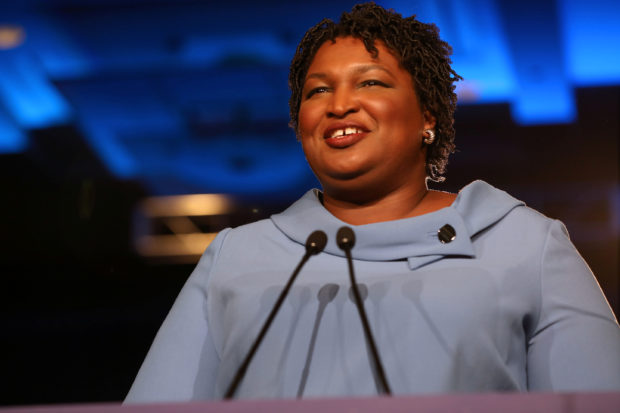 Stacey Abrams speaks to the crowd of supporters announcing they will wait till the morning for results of the mid-terms election at the Hyatt Regency in Atlanta, Georgia, U.S. November 7, 2018. REUTERS/Lawrence Bryant - RC19D7CE1860