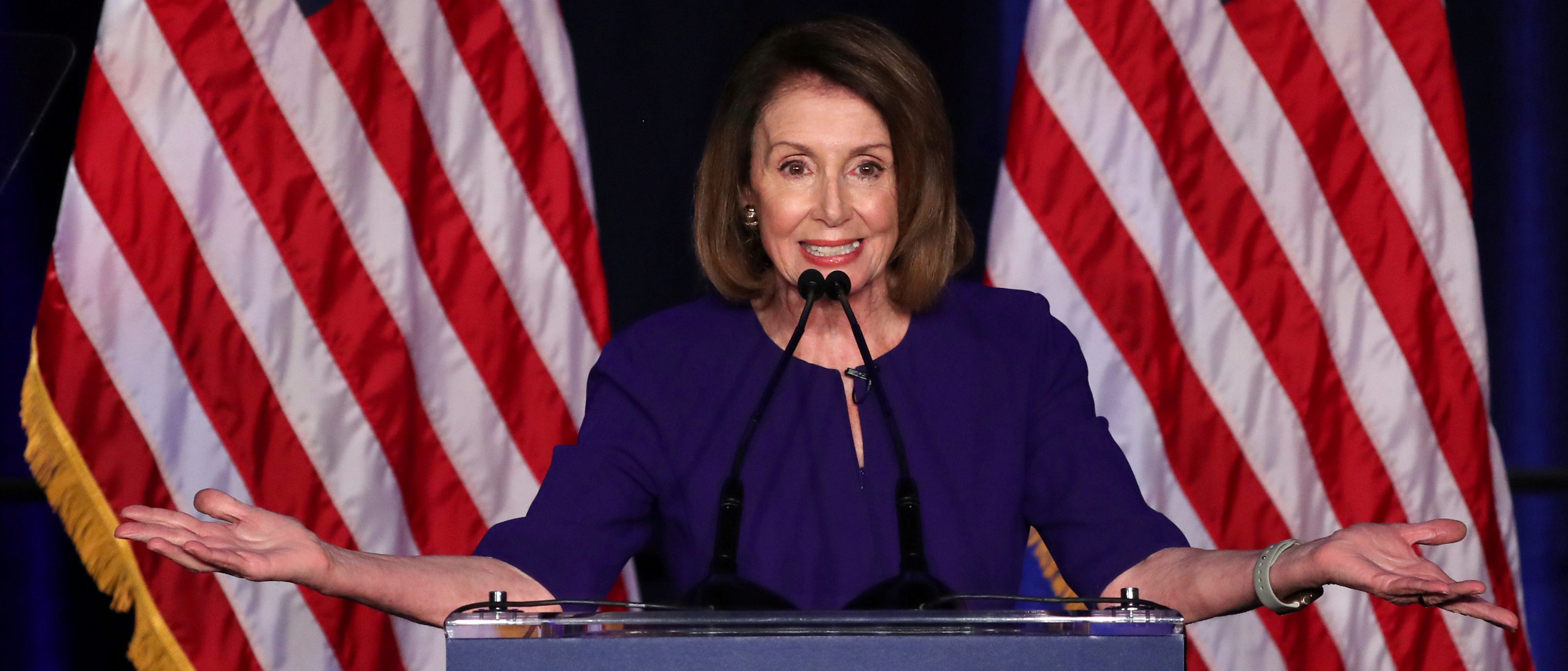 U.S. House Minority Leader Nancy Pelosi reacts to the results of the U.S. midterm elections at a Democratic election night party and rally in Washington, U.S. November 6, 2018. REUTERS/Jonathan Ernst - RC1889CBEC00