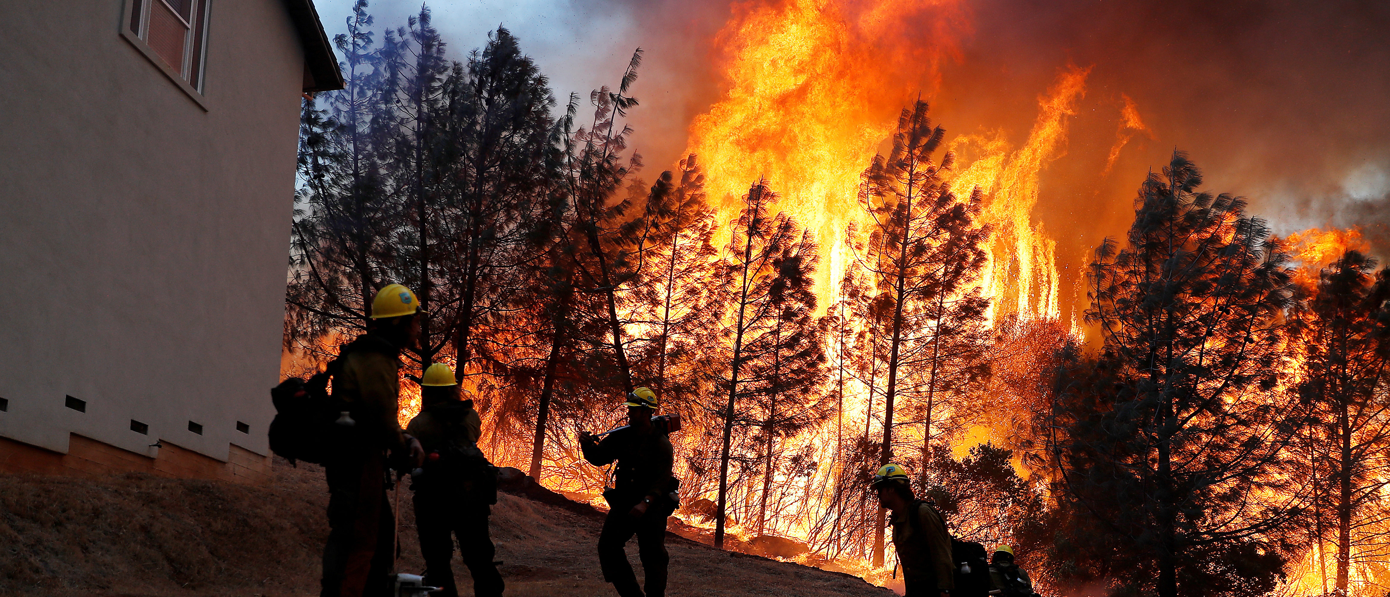 A group of U.S. Forest Service firefighters monitor a back fire while battling to save homes at the Camp Fire in Paradise, California, U.S. November 8, 2018. REUTERS/Stephen Lam TPX IMAGES OF THE DAY - RC13174EDFB0
