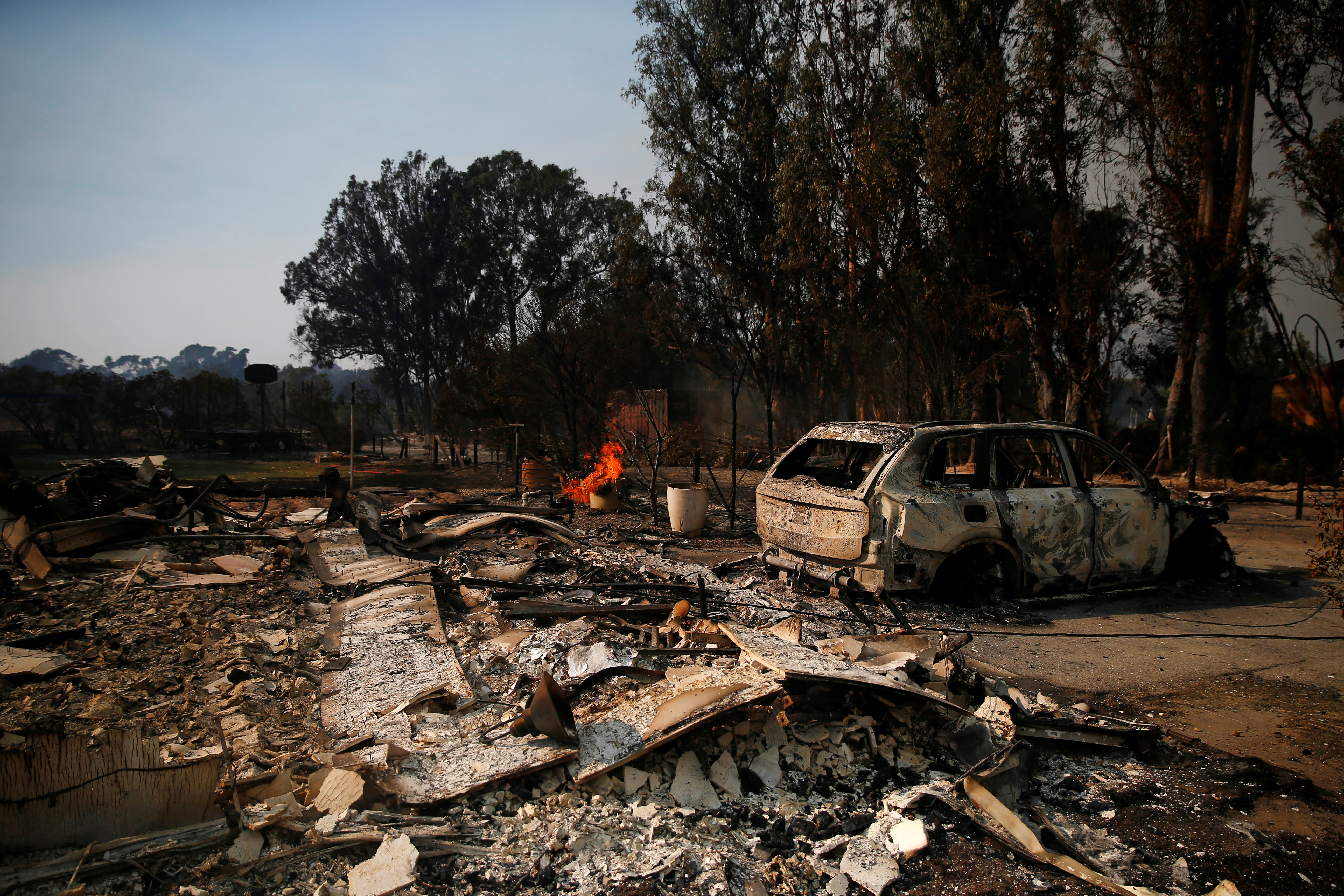 A destroyed home is seen as the Woolsey Fire continues to burn in Malibu