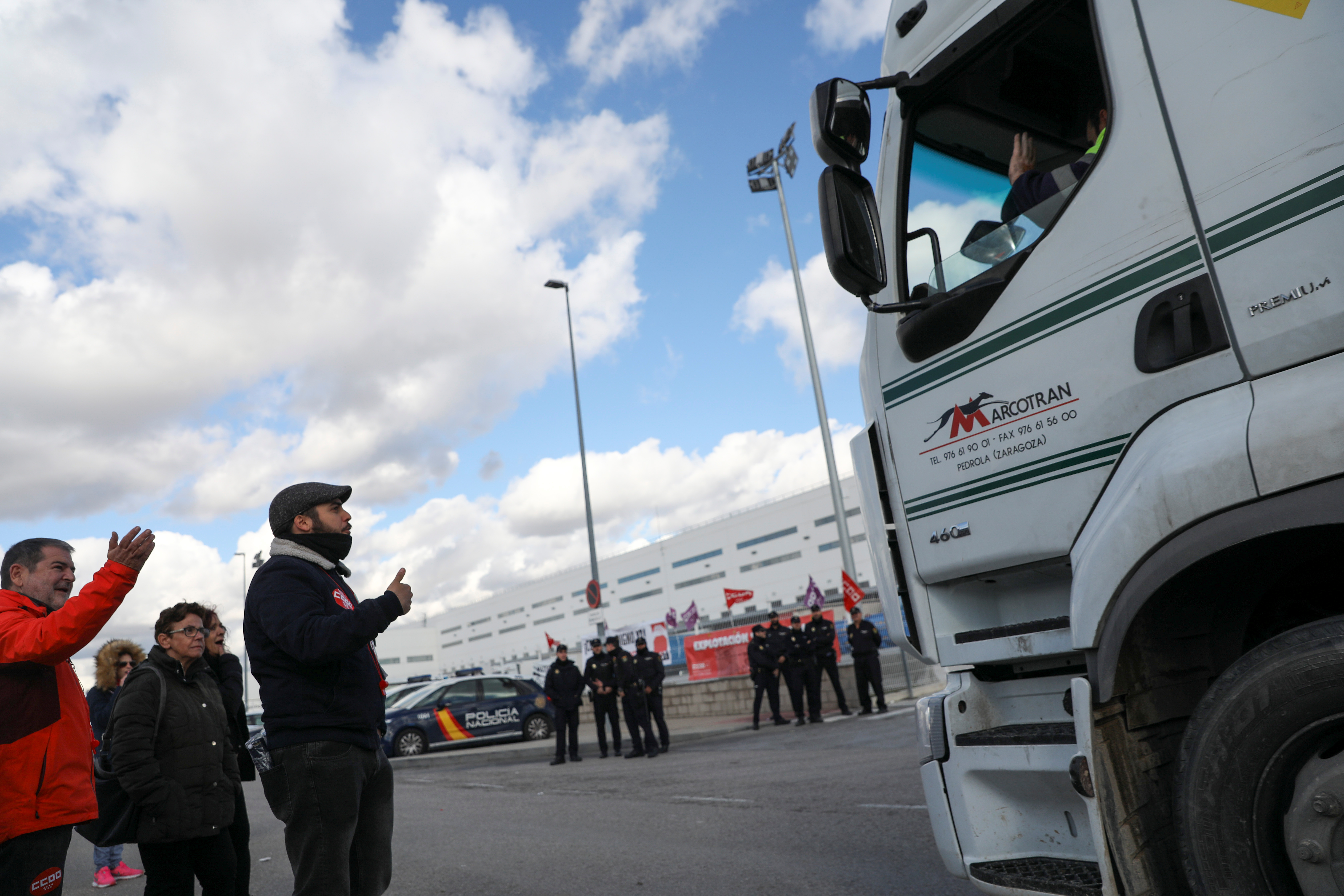 Pickets gesture to a truck driver outside an Amazon fulfillment centre during a strike in San Fernando de Henares near Madrid, Spain, November 23, 2018. REUTERS/Susana Vera