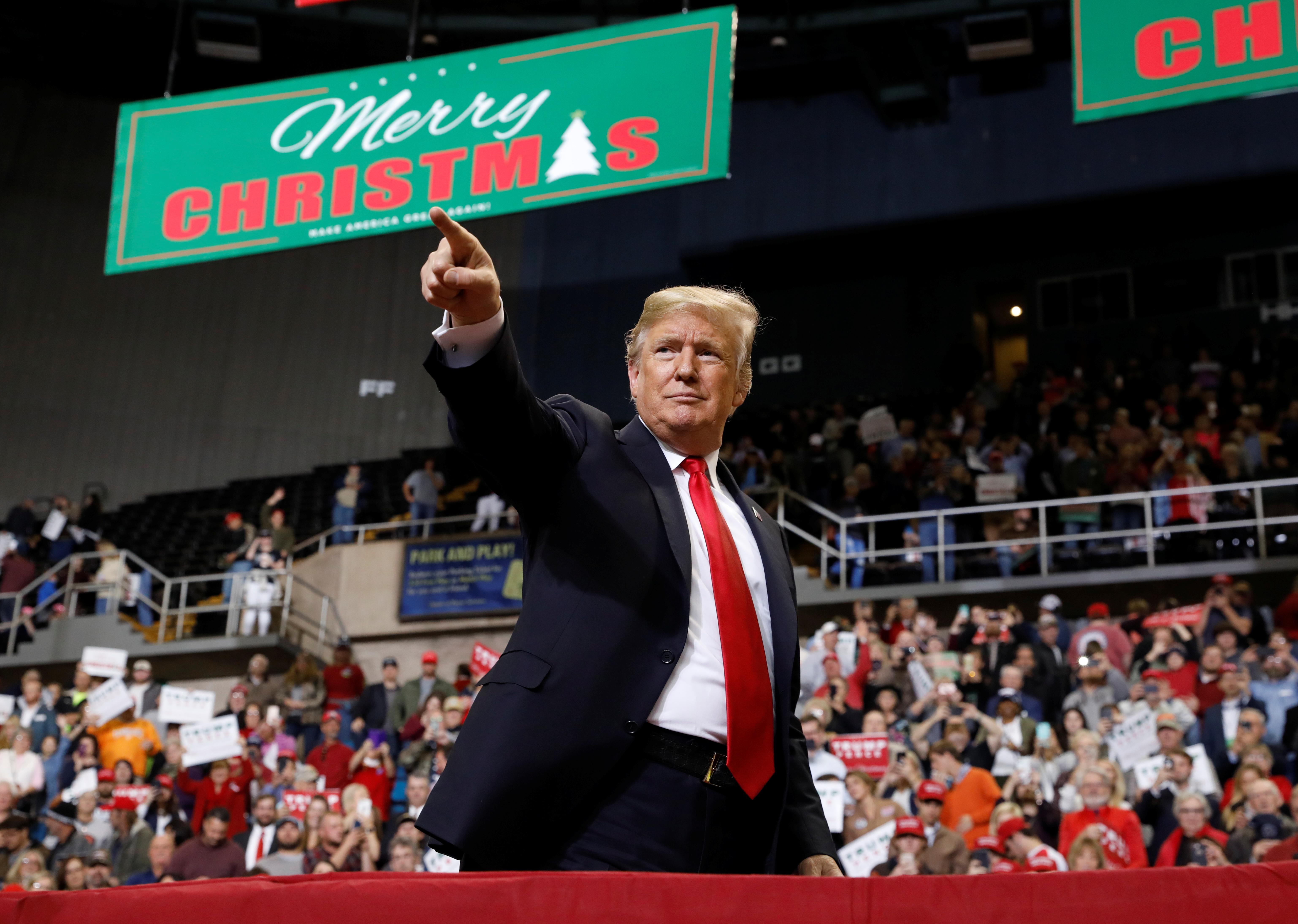 U.S. President Trump gestures during a Make America Great Again rally in Biloxi