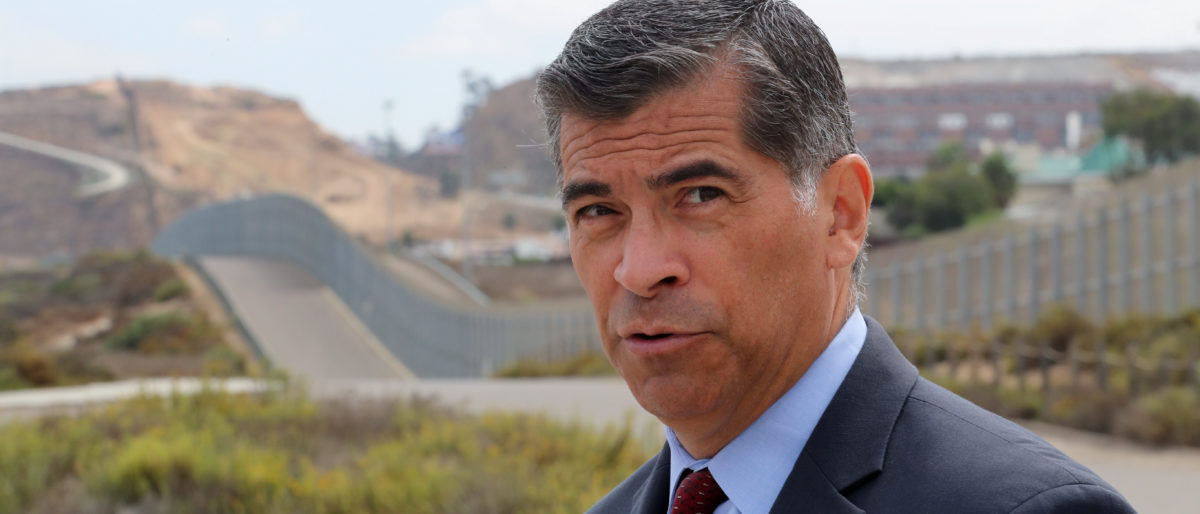 Attorney General of California Xavier Becerra walks along the U.S.-Mexico border at the Pacific Ocean after announcing a lawsuit against the Trump Administration over its plans to begin construction of border wall in San Diego and Imperial Counties, in San Diego, California, U.S., Sept. 20, 2017. REUTERS/Mike Blake
