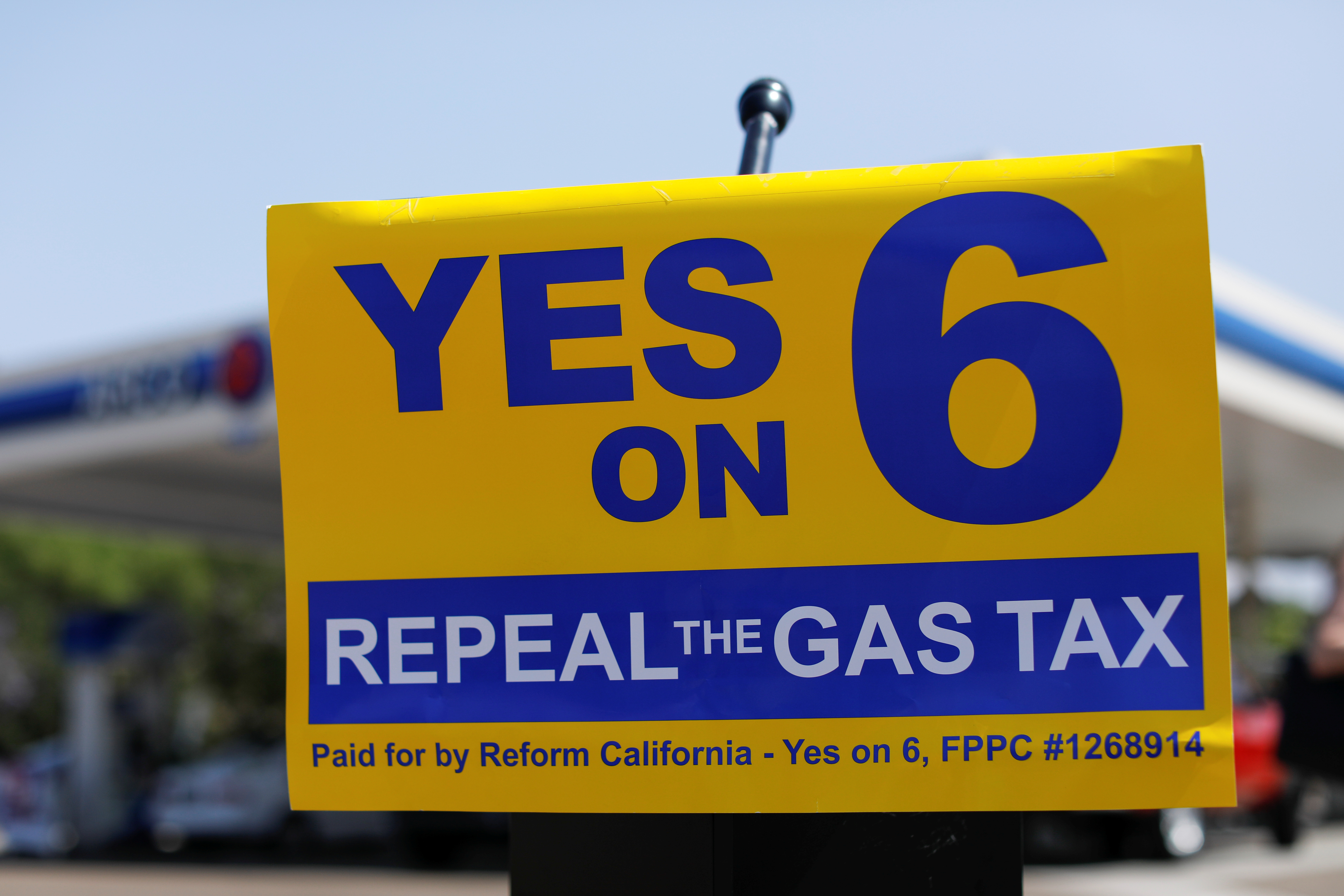 A California Proposition 6 six sign is shown as the growing movement to repeal a state gas tax holds an event at an Arco Gas station in San Diego