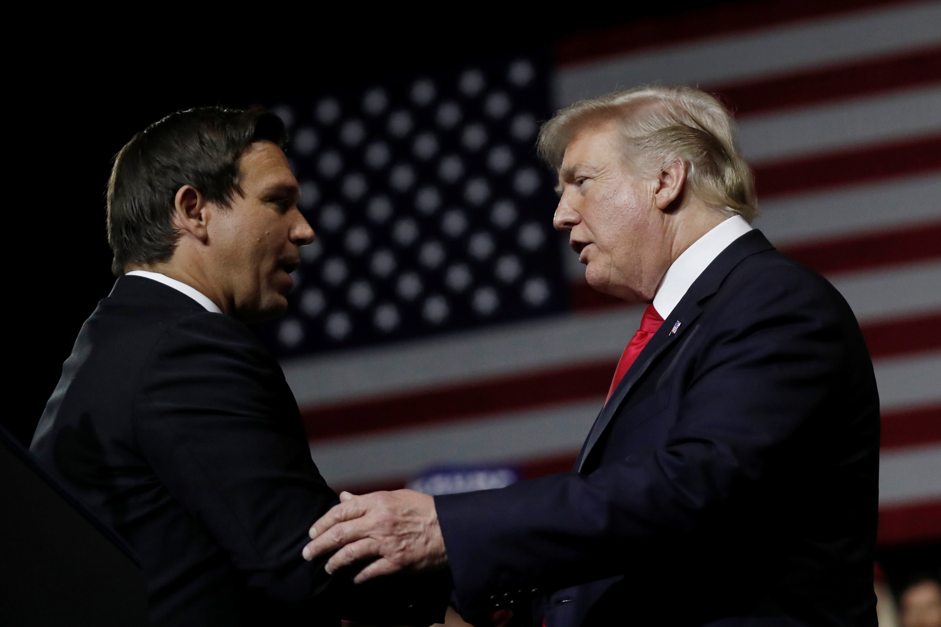 U.S. President Donald Trump talks with Republican Florida governor candidate Ron DeSantis during a Make America Great Again Rally at the Florida State Fairgrounds in Tampa, Florida, U.S., July 31, 2018. REUTERS/Carlos Barria