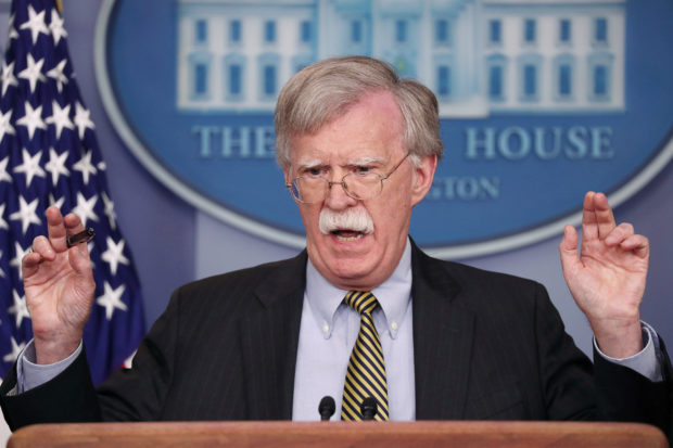 FILE PHOTO: U.S. National Security Adviser John Bolton answers a question from a reporter about how he refers to Palestine during a news conference in the White House briefing room in Washington, U.S., October 3, 2018. REUTERS/Jonathan Ernst/File Photo - RC18BF8B9EC0
