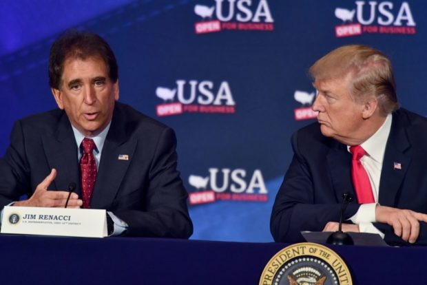 US President Donald Trump listens to US Representative Jim Renacci (L) during a roundtable discussion on the new tax law at the Cleveland Public Auditorium and Conference Center on May 5, 2018, in Cleveland, Ohio. (NICHOLAS KAMM/AFP/Getty Images)