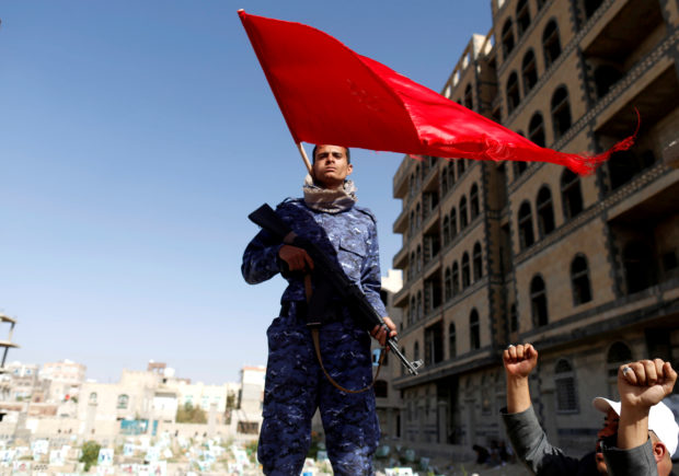 A Shiite Houthi fighter stands guard at the site of a rally attended by fellows Houthis to mark Ashura and the 4th anniversary of their takeover of the Yemeni capital, in Sanaa, Yemen, September 20, 2018. REUTERS/Khaled Abdullah