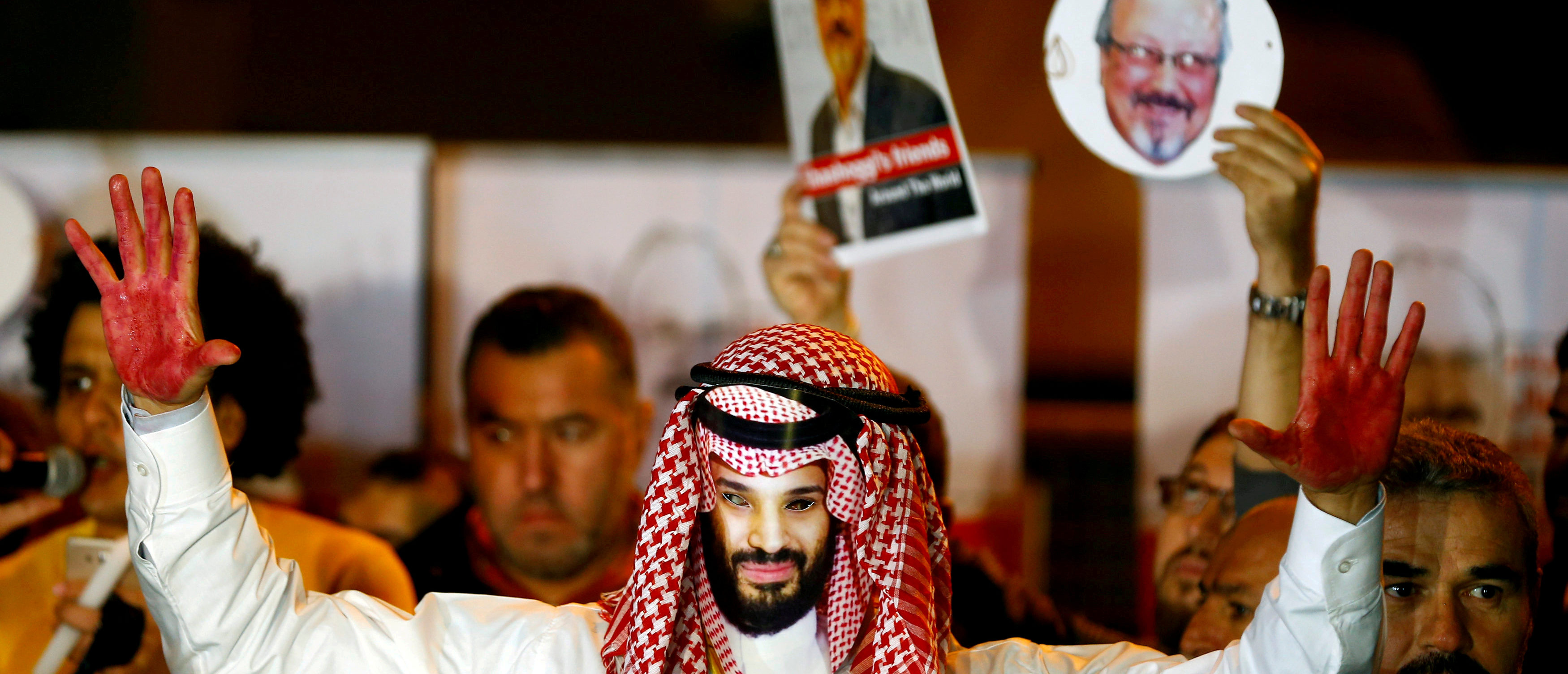 A demonstrator wearing a mask of Saudi Crown Prince Mohammed bin Salman attends a protest outside the Saudi Arabia consulate in Istanbul, Turkey October 25, 2018. REUTERS/Osman Orsal