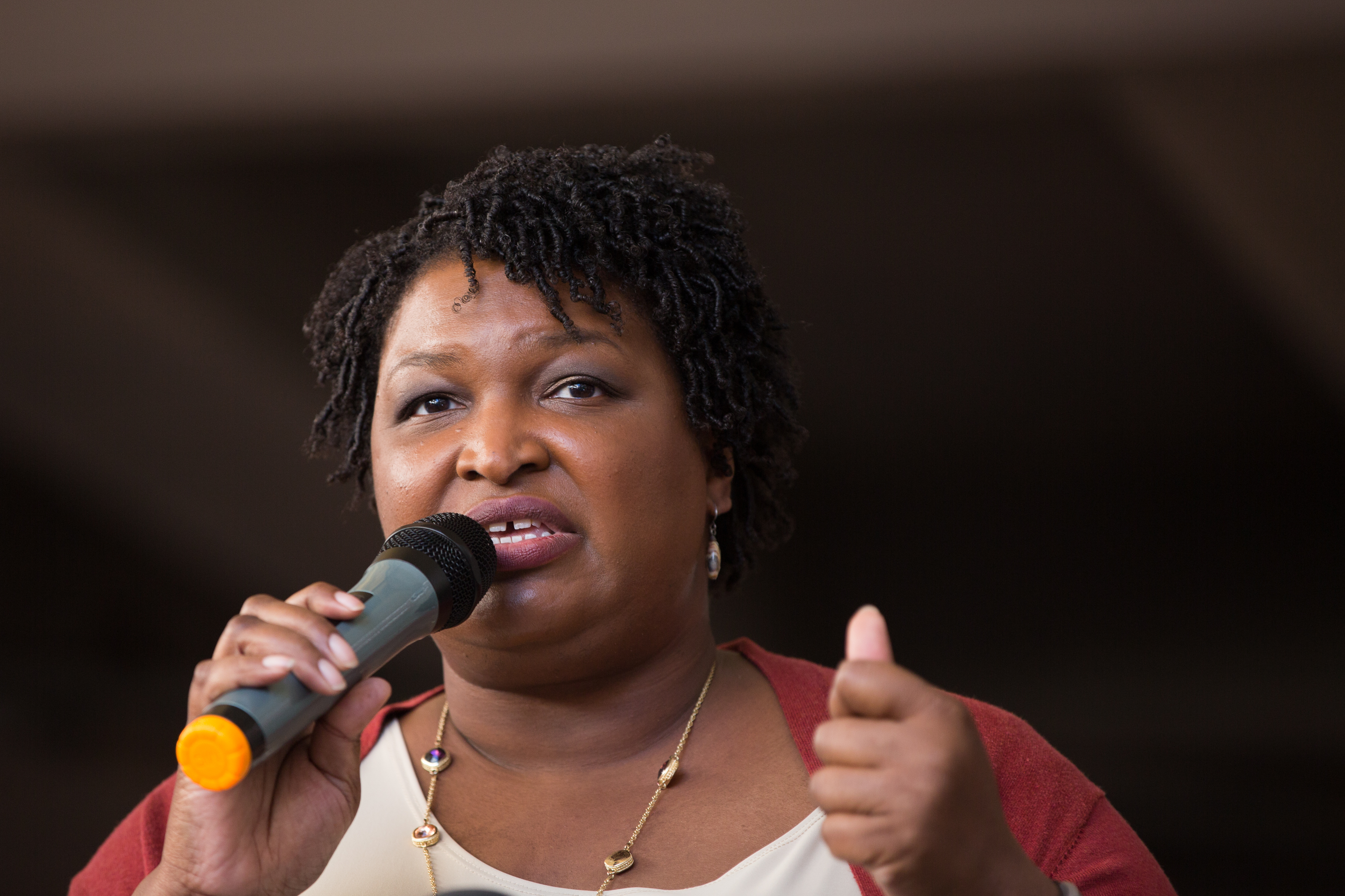 "ATLANTA, GA - OCTOBER 28: Democratic Georgia Gubernatorial candidate Stacey Abrams talks to a crowd gathered for the ""Souls to The Polls"" march in downtown Atlanta on October 28, 2018 in Atlanta, Georgia. (Jessica McGowan/Getty Images)"