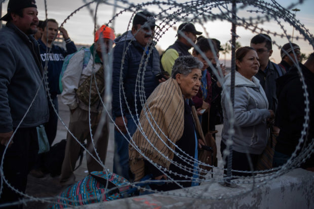 Concertina wire is pictured as people wait in line at the San Ysidro Port of Entry after the land border crossing was temporarily closed to foot and vehicle traffic from Tijuana, Mexico November 19, 2018. REUTERS/Adrees Latif
