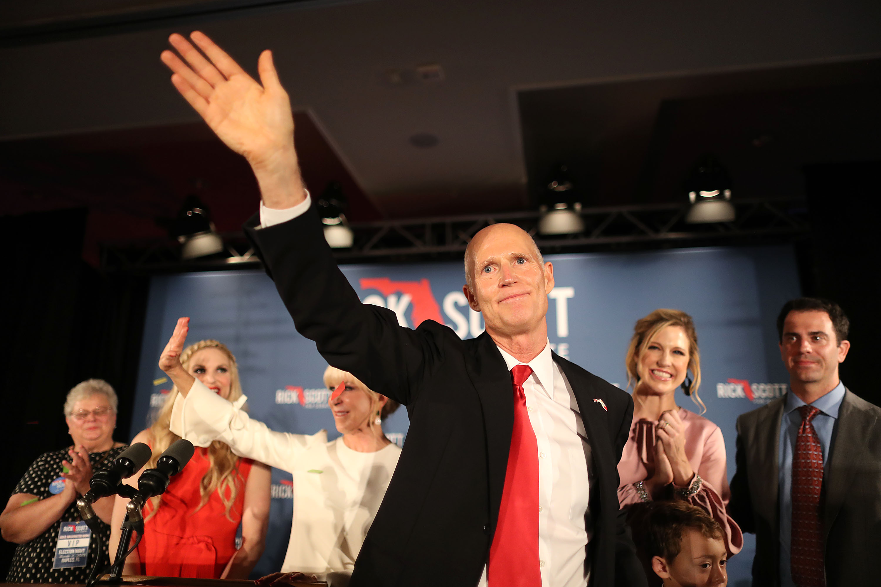 Florida Governor Rick Scott and his wife, Ann Scott, along with their daughters, Jordan Scott (L) and Alison Guimard (2nd R) take to the stage during his election night party at the LaPlaya Beach & Golf Resort on November 06, 2018 in Naples, Florida. (Joe Raedle/Getty Images)