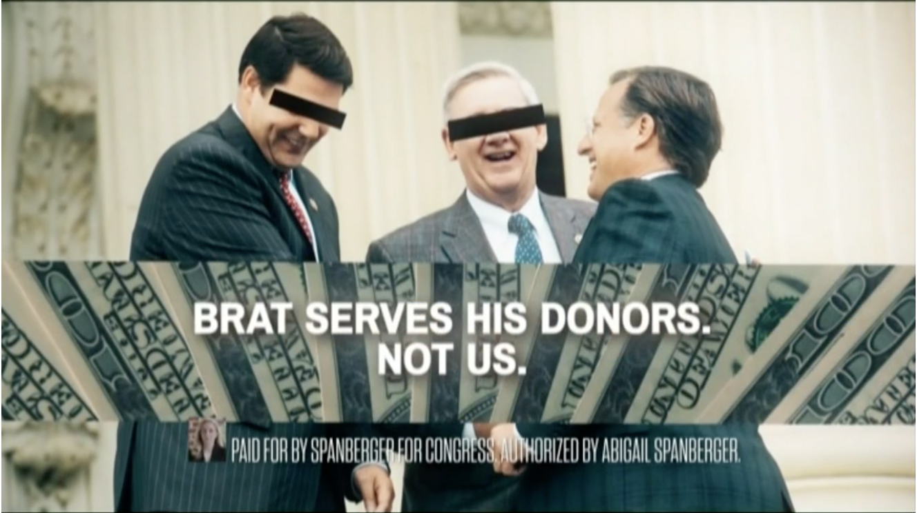 Democrat Abigail Spanberger ran a still ad with a photo of Republican Virginia Rep. Dave Brat laughing with two suit-clad men. The unedited photo shows Brat with fellow Republicans Texas Rep. Jodey Arrington and Michigan Rep. Paul Mitchell, not donors. Screenshot/Brat campaign