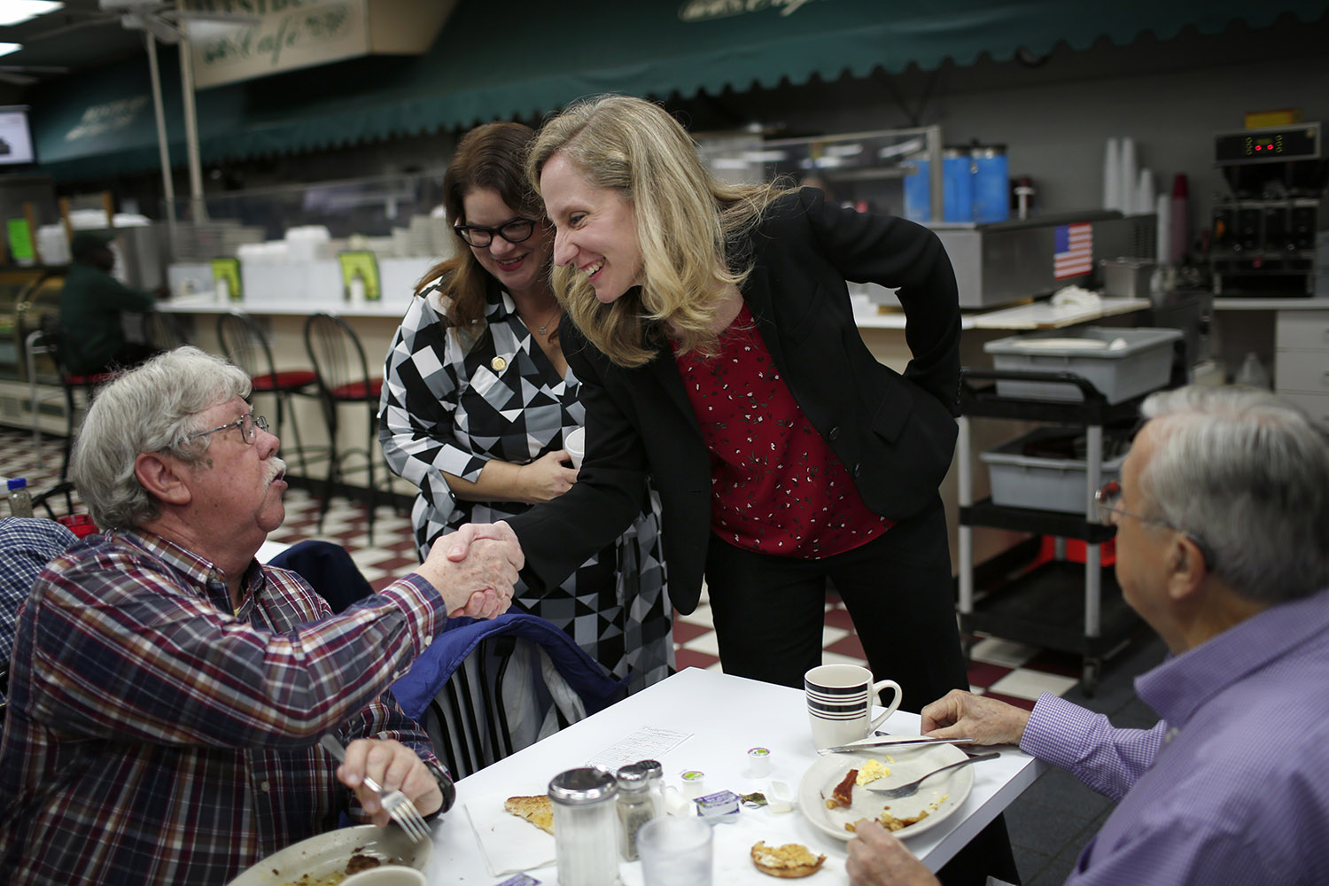 Abigail Spanberger, Democratic candidate for Virginia's Seventh District in the U.S. House of Representatives, greets breakfast diners at Westbury Apothecary's cafe, November 5, 2018 in Richmond, Virginia. Spanberger, a former CIA officer and first time candidate, is running against Rep. Dave Brat (R-VA) in a race that is expected to be very close as the U.S. holds its midterm elections tomorrow. (Photo by Win McNamee/Getty Images)