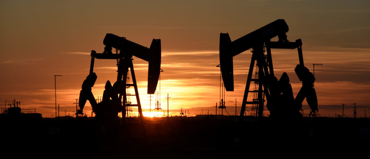 Pump jacks operate at sunset in an oil field in Midland, Texas U.S. August 22, 2018. Picture taken August 22, 2018. REUTERS/Nick Oxford