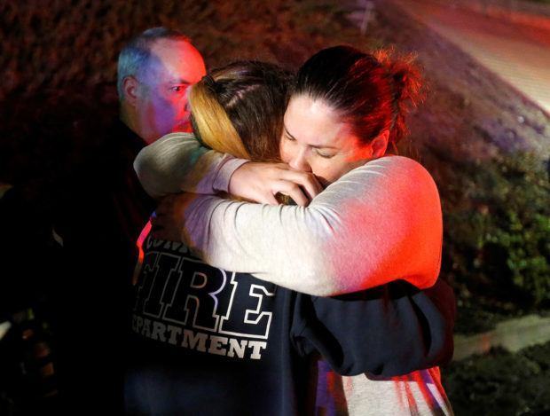 People comfort each other after a mass shooting at a bar in Thousand Oaks, California, U.S. November 8, 2018. REUTERS/Ringo Chiu