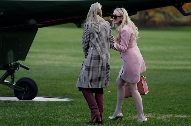 Tiffany Trump, right, and White House senior advisor Ivanka Trump walk to board Marine One to depart for travel to Mar-a-Lago with U.S. President Donald Trump from the White House in Washington, U.S., November 20, 2018. REUTERS/Leah Millis