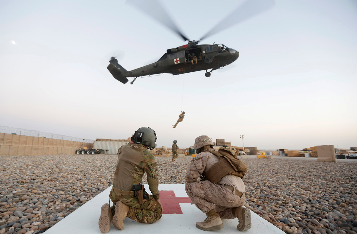 A U.S. Navy Corpsman and U.S. soldier take part in a helicopter Medevac exercise in Helmand province, Afghanistan, July 6, 2017.REUTERS/Omar Sobhani