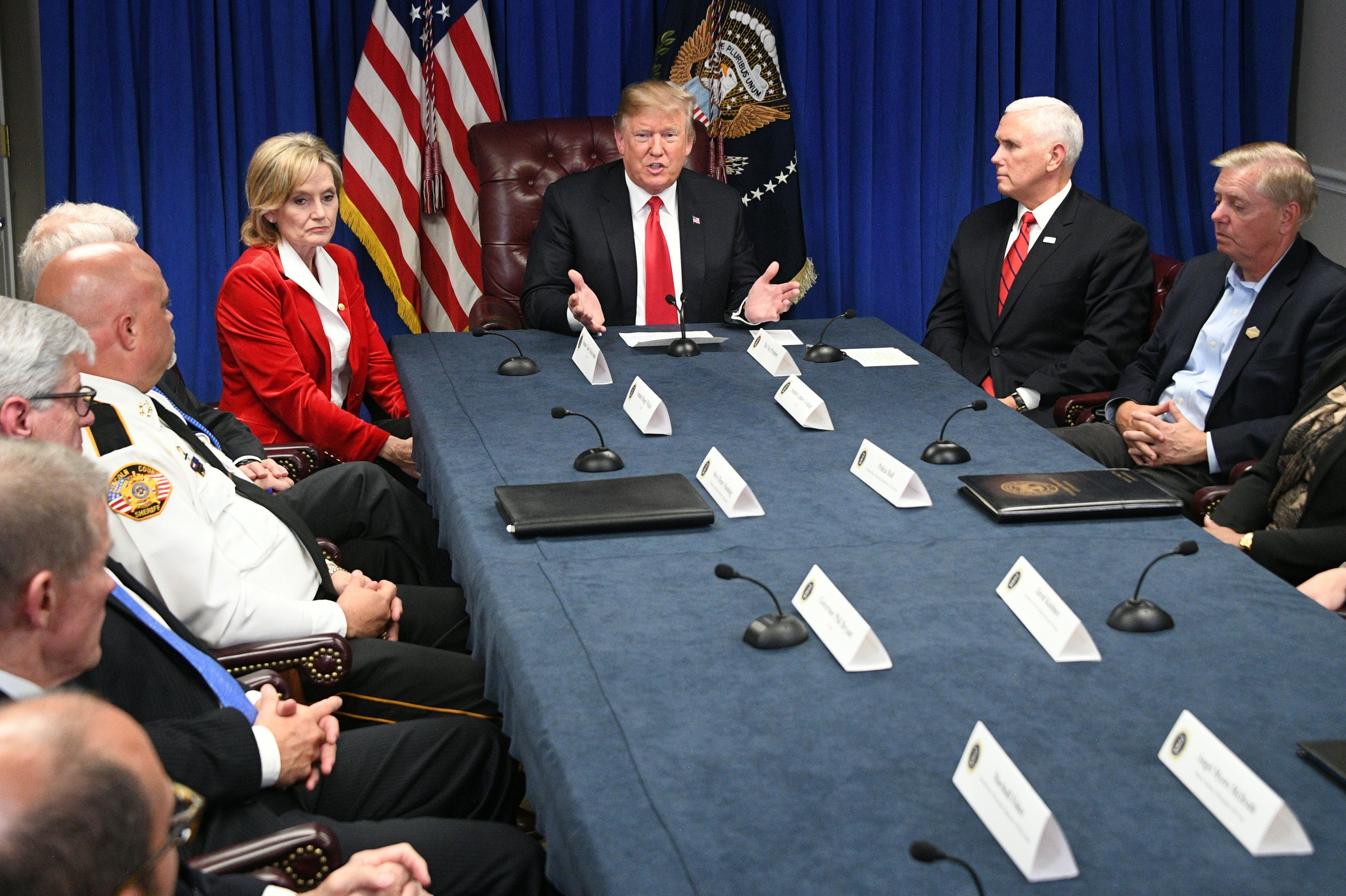 US President Donald Trump (C), Senator Cindy Hyde-Smith (L), Vice President Mike Pence (2ndfrom R) and Senator Lindsey Graham (R) participate in a roundtable on the FIRST STEP Act in Gulfport, Mississippi on November 26, 2018. (JIM WATSON/AFP/Getty Images)