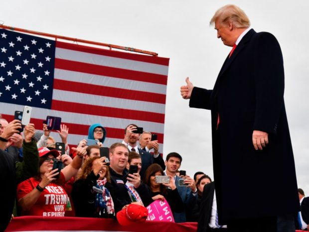 US President Donald Trump arrives to speak at a campaign rally at the Huntington Tri-State Airport, on November 2, 2018, in Huntington, West Virginia. (NICHOLAS KAMM/AFP/Getty Images)