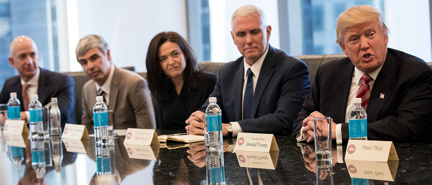 (L to R) Jeff Bezos, chief executive officer of Amazon, Larry Page, chief executive officer of Alphabet Inc. (parent company of Google), Sheryl Sandberg, chief operating officer of Facebook, Vice President-elect Mike Pence listen as President-elect Donald Trump speaks during a meeting of technology executives at Trump Tower, December 14, 2016 in New York City. This is the first major meeting between President-elect Trump and technology industry leaders. (Photo by Drew Angerer/Getty Images)