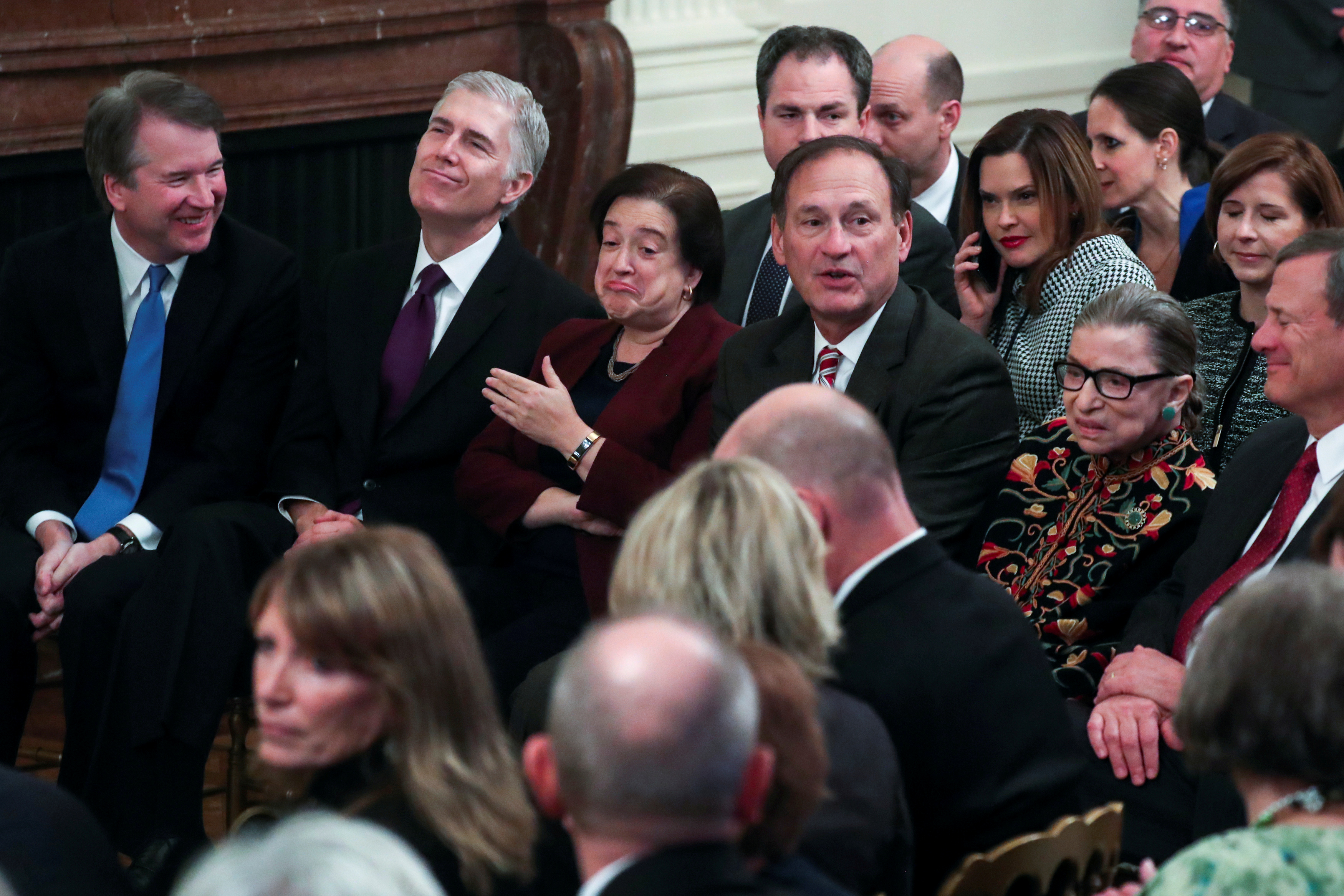 U.S. Supreme Court Associate Justices Brett Kavanaugh, Neil Gorsuch, Elena Kagan, Samuel Alito, Ruth Bader Ginsburg and Chief Justice John Roberts attend a ceremony with President Donald Trump awarding the 2018 Presidential Medals of Freedom in the East Room of the White House in Washington, U.S. November 16, 2018. REUTERS/Jonathan Ernst