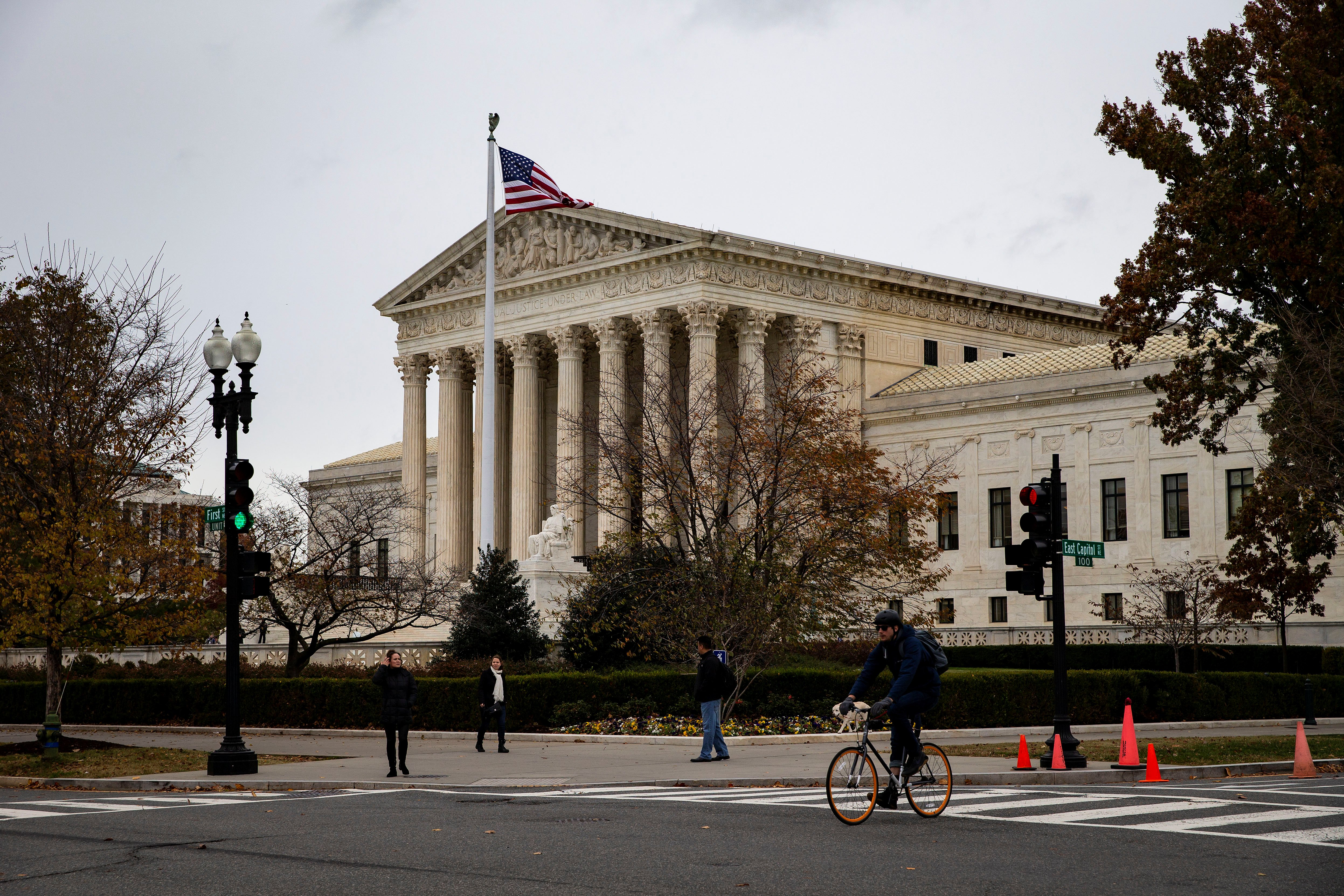 A man rides a bicycle past the Supreme Court in Washington, U.S., November 13, 2018. REUTERS/Al Drago