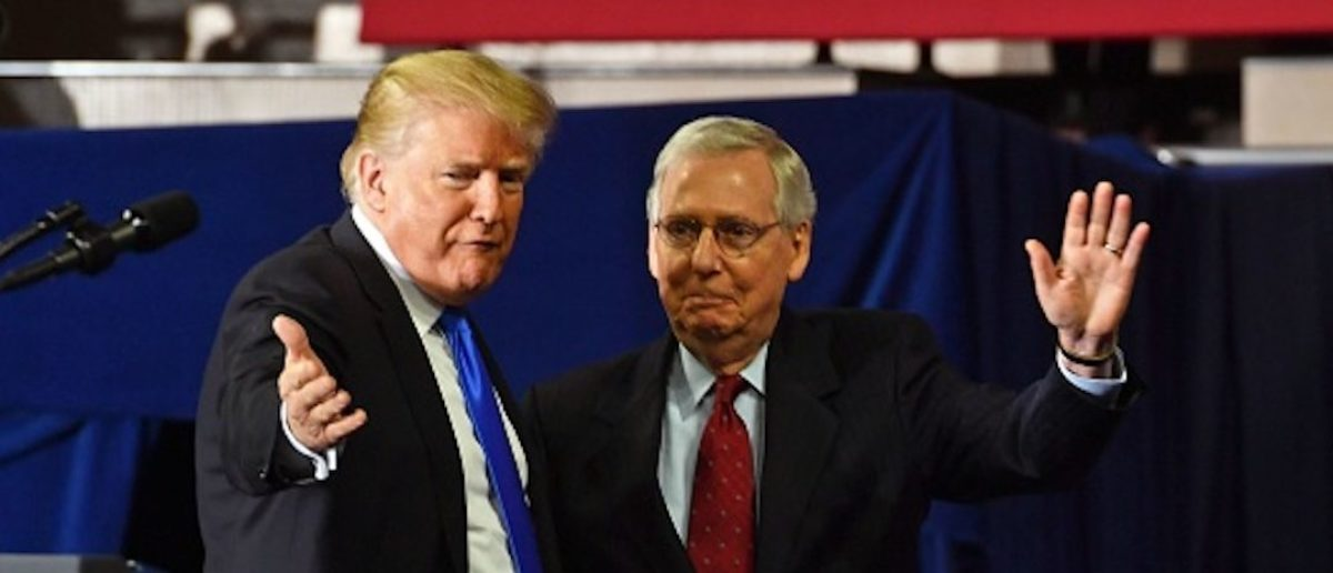 """US President Donald Trump (L) introduces US Senate Majority Leader Mitch McConnell (R-KY) during a """"Make America Great Again"""" rally at the Eastern Kentucky University, in Richmond, Kentucky, on October 13, 2018. (Photo: read NICHOLAS KAMM/AFP/Getty Images)"""