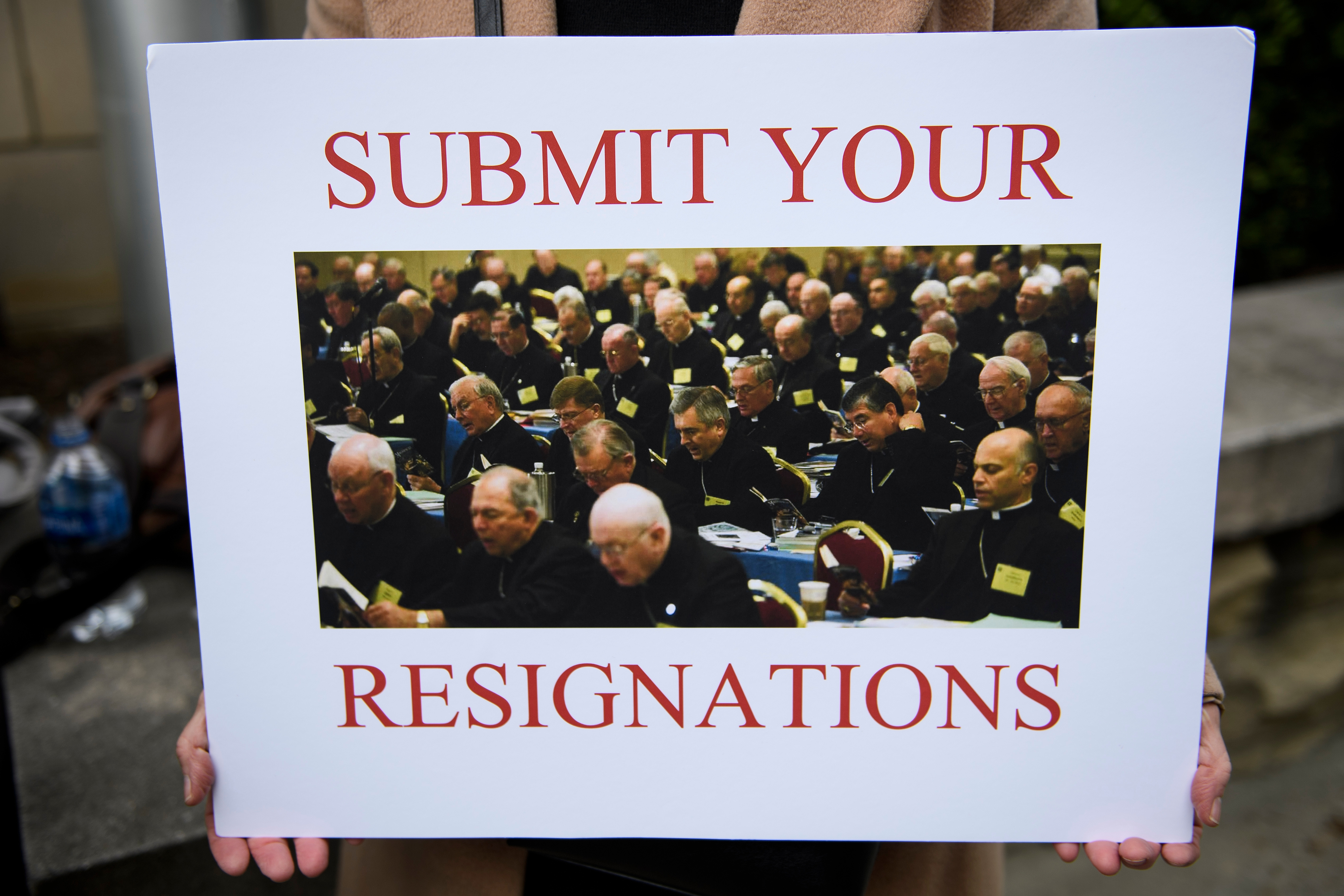 A protester holds a sign during the annual US Conference of Catholic Bishops November 12, 2018 in Baltimore, Maryland. ( BRENDAN SMIALOWSKI/AFP/Getty Images)